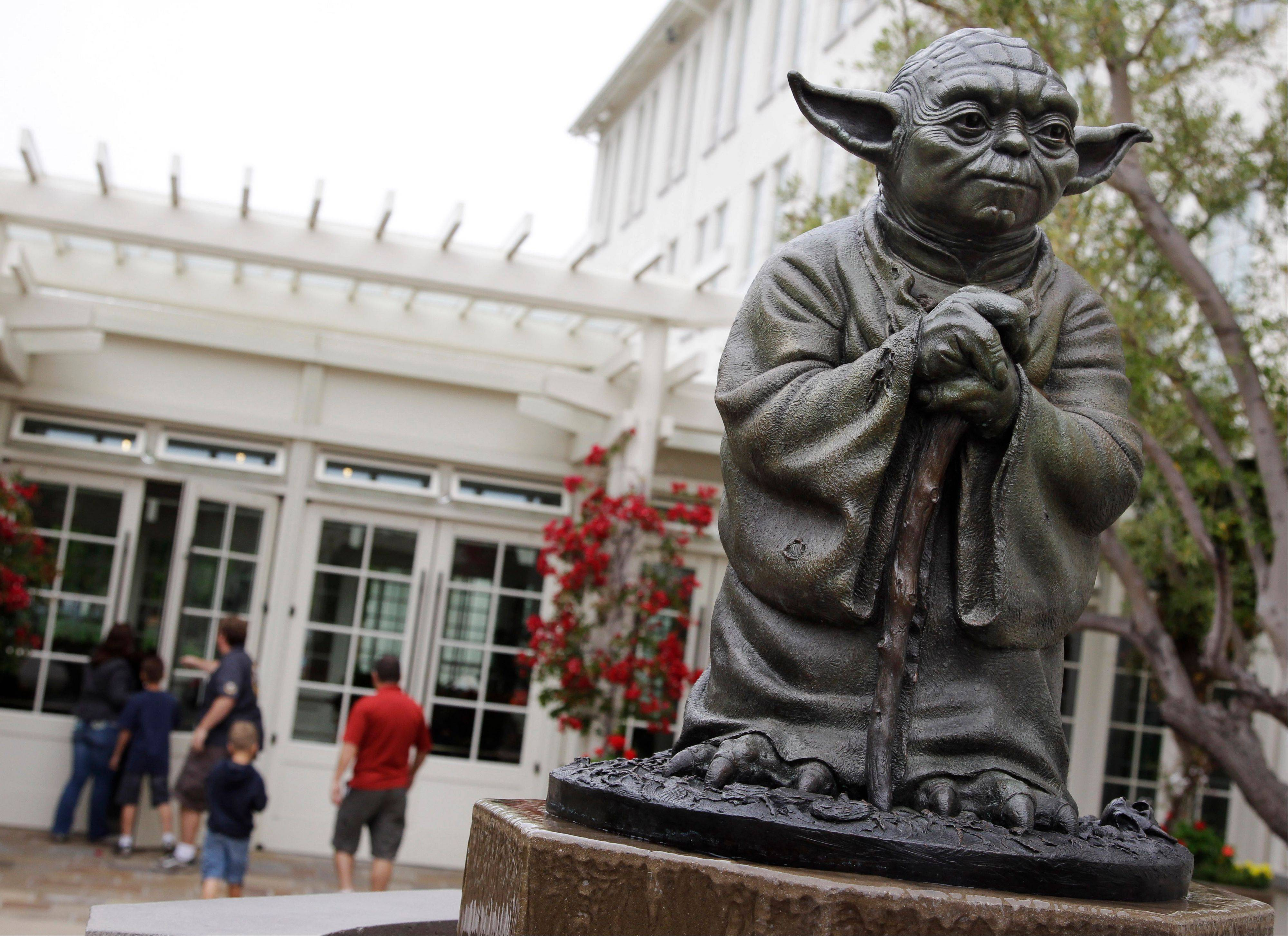"A life-size replica of Yoda, George Lucas' master of the Force standing outside the Lucasfilm Ltd. production studios in San Francisco, is one of many special sites visited by ""Star Wars"" fans."
