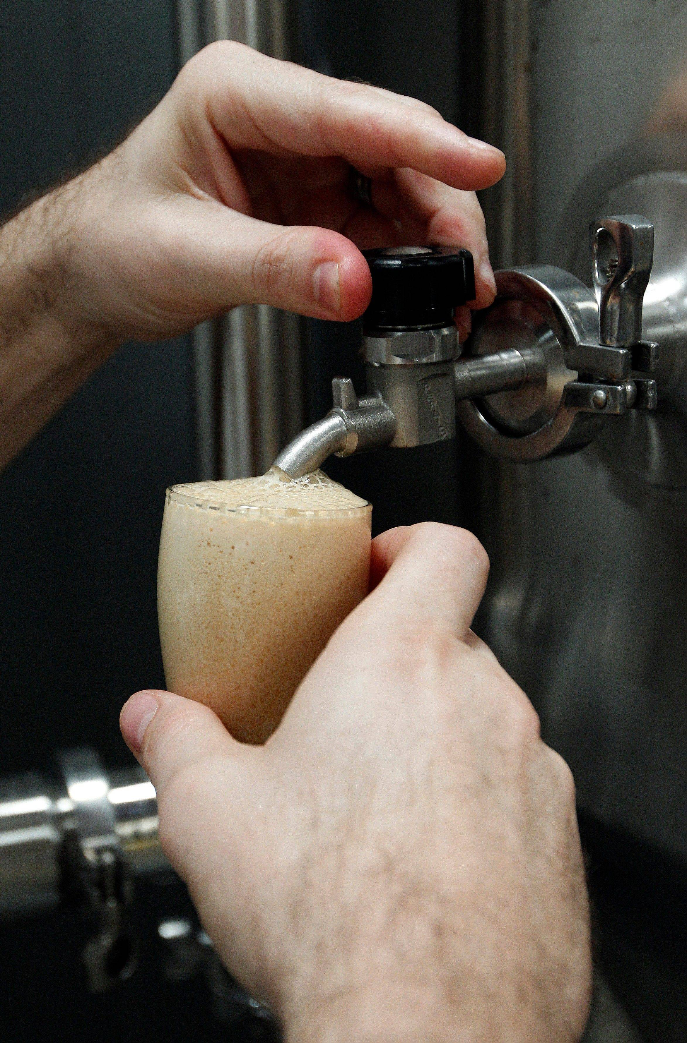 Joey Redner pours a beer sample at Cigar City Brewing Co. in Tampa, Fla. Cigar City uses ingredients such as Spanish cedar, guava, Cuban espresso and citrus woods to craft beers that taste of Tampa's heritage.