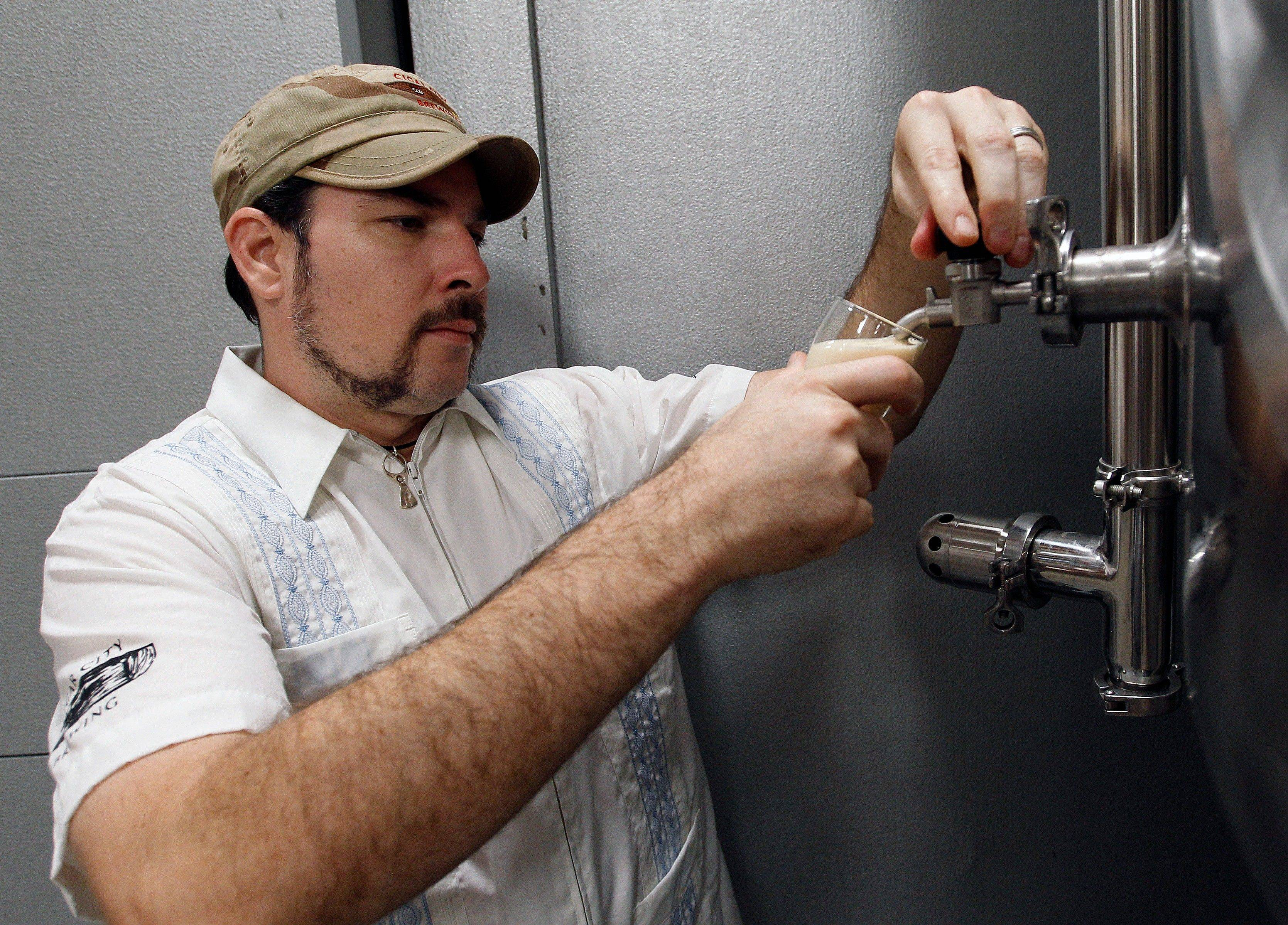 Joey Redner pours a beer sample from the brewing room at Cigar City Brewing Co. in Tampa, Fla. Cigar City uses ingredients such as Spanish cedar, guava, Cuban espresso and citrus woods to craft beers that taste of Tampa's heritage.