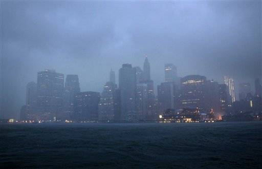 Lower Manhattan is seen amidst dark clouds in New York, Sunday, Aug. 28, 2011. Hurricane Irene bore down on a dark and quiet New York e