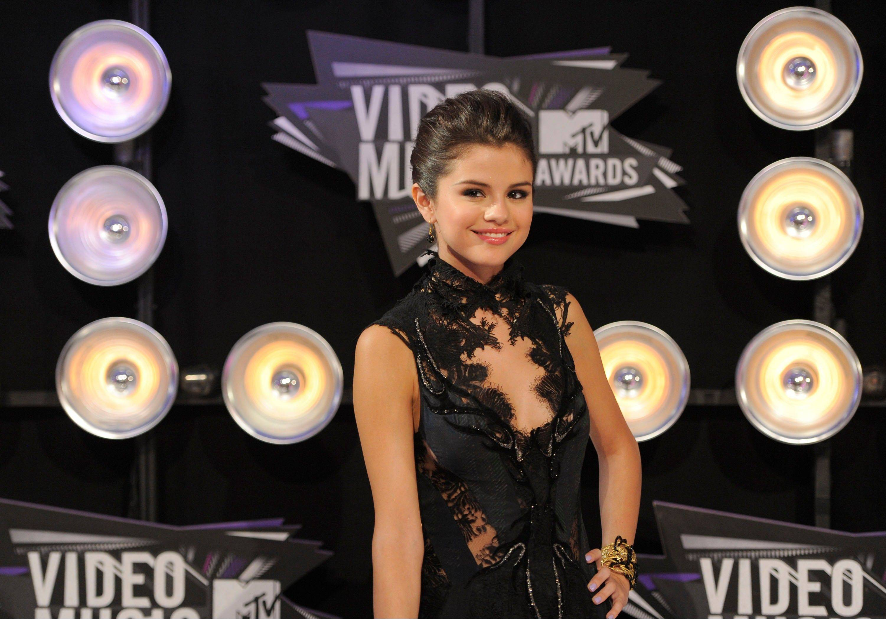 Selena Gomez arrives at the MTV Video Music Awards on Sunday in Los Angeles.