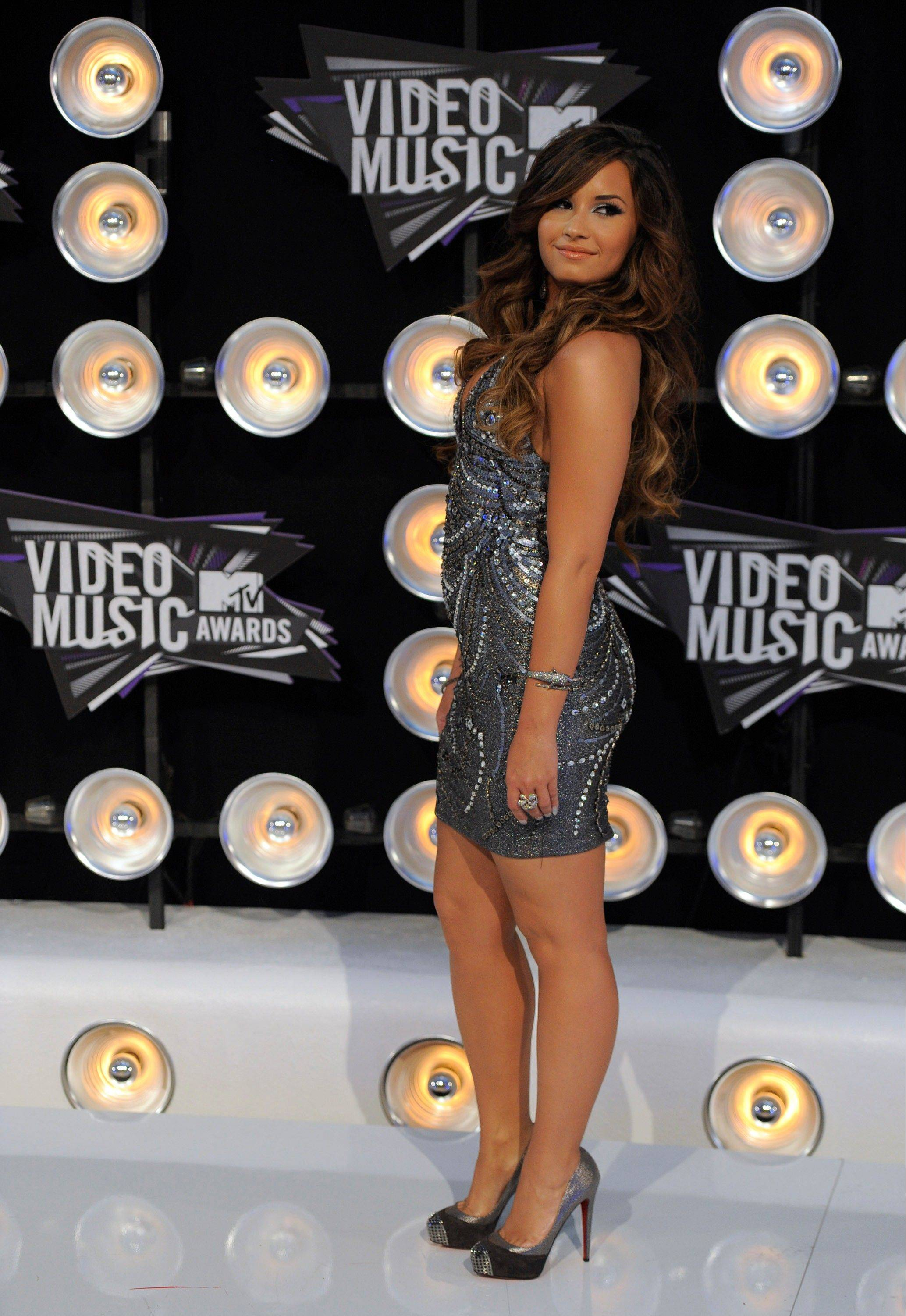 Actress and singer Demi Lovato arrives at the MTV Video Music Awards on Sunday in Los Angeles.