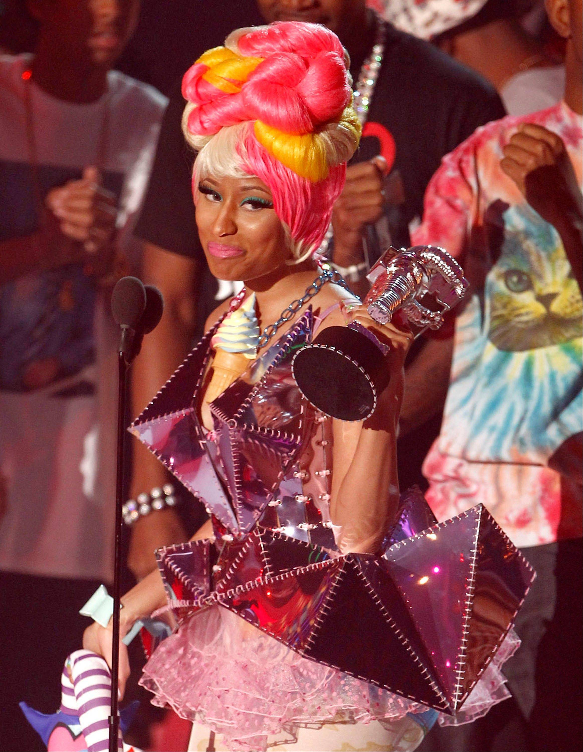 "Nicki Minaj accepts the best hip hop video award for ""Super Bass"" at the MTV Video Music Awards."