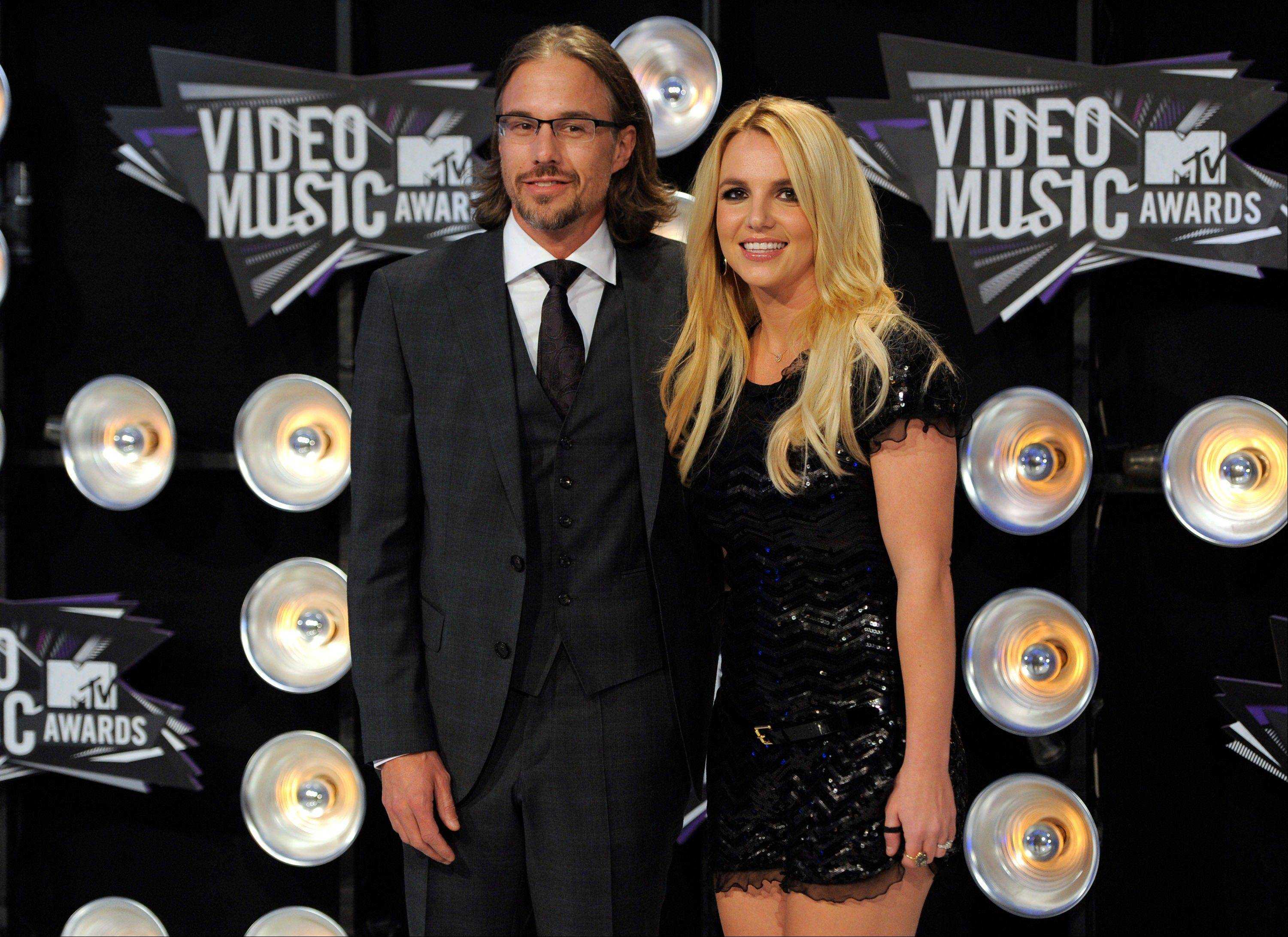 Jason Trawick, left, and Britney Spears arrive at the MTV Video Music Awards on Sunday in Los Angeles.