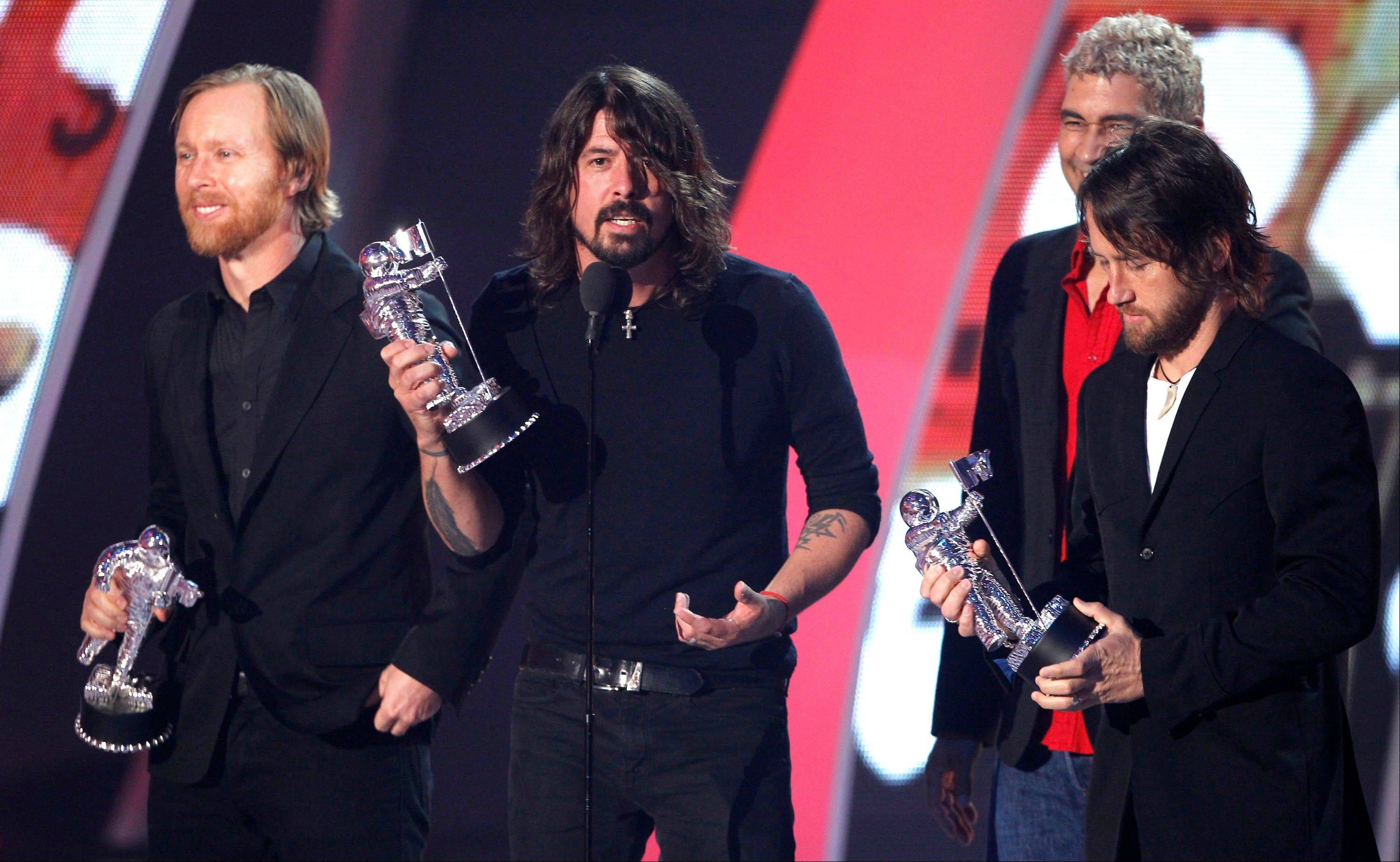 "Foo Fighters accept the award for best rock video for ""Walk"" at the VMAs."
