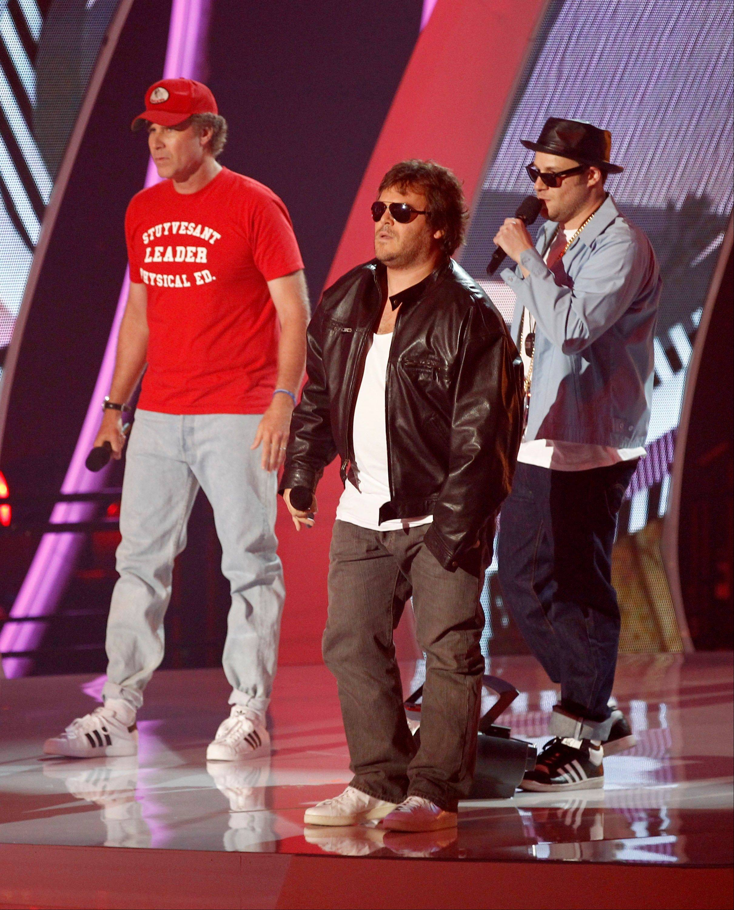 From left, Will Ferrell, Jack Black and Seth Rogan are seen on stage at the MTV Video Music Awards on Sunday in Los Angeles.