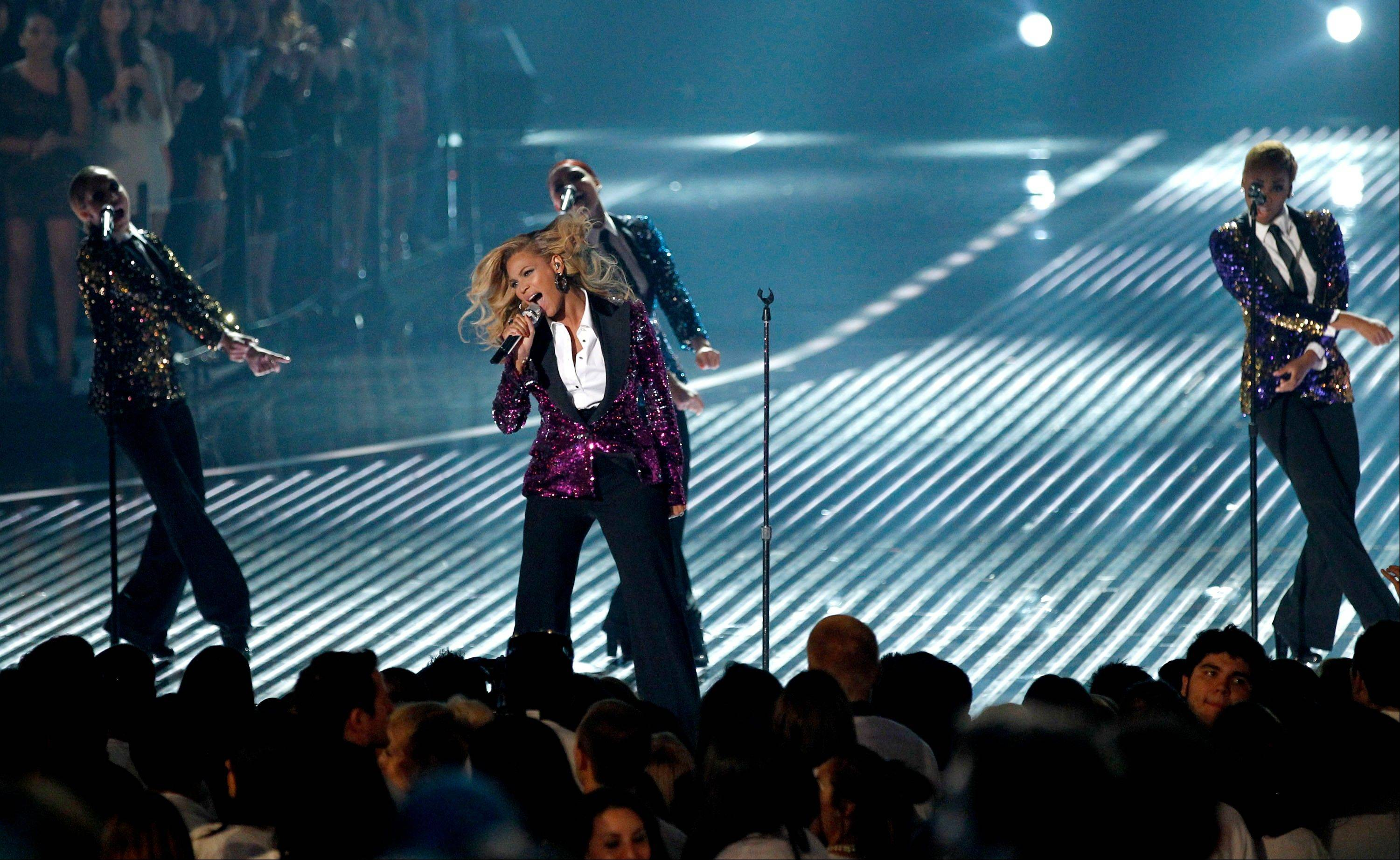 Beyonce, center, fresh off the news that she's expecting her first child with husband and hip-hop artist Jay-A performs at the MTV Video Music Awards on Sunday in Los Angeles.
