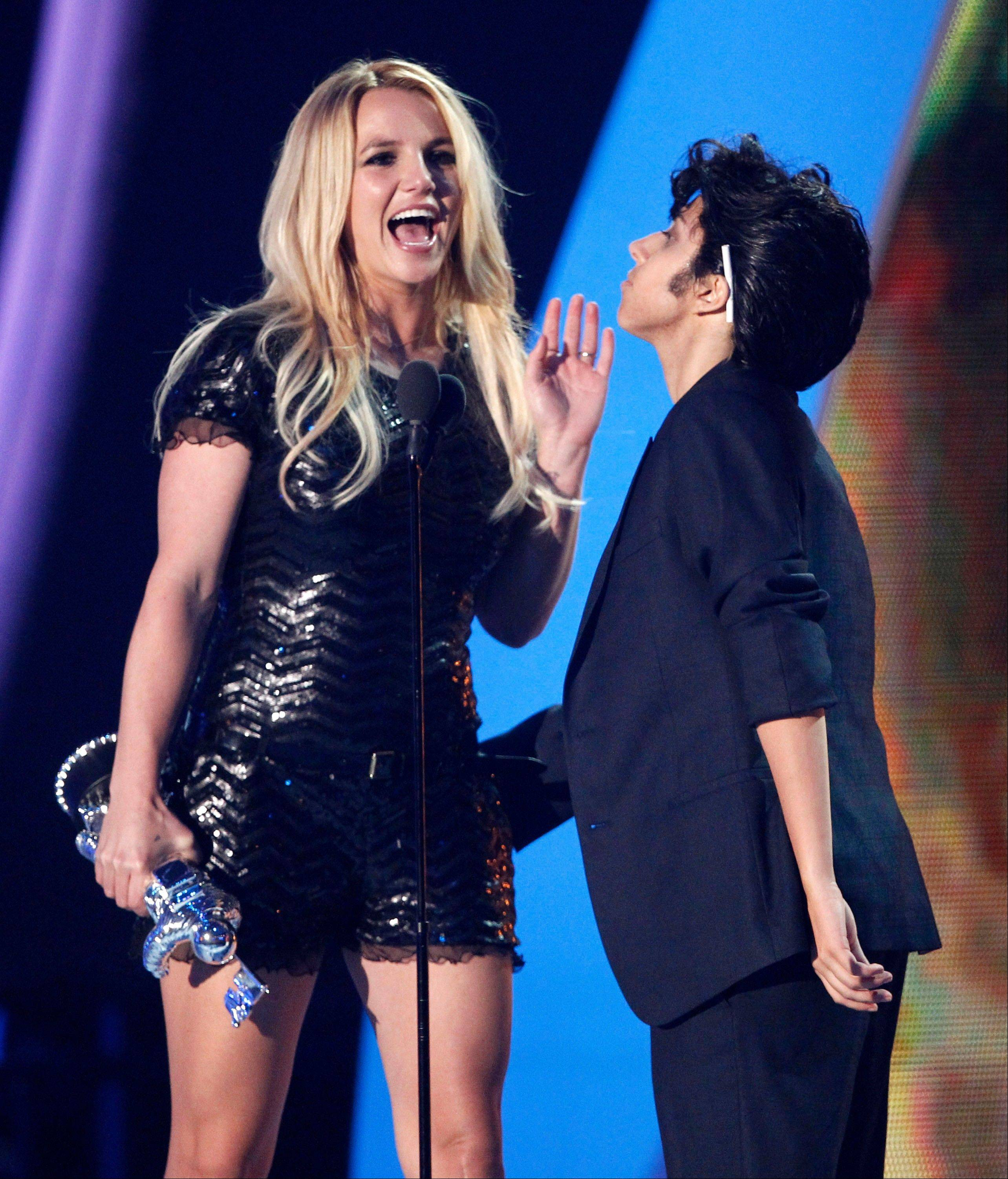 Lady Gaga, right, presents Britney Spears with the Video Vanguard award at the MTV Video Music Awards on Sunday in Los Angeles.