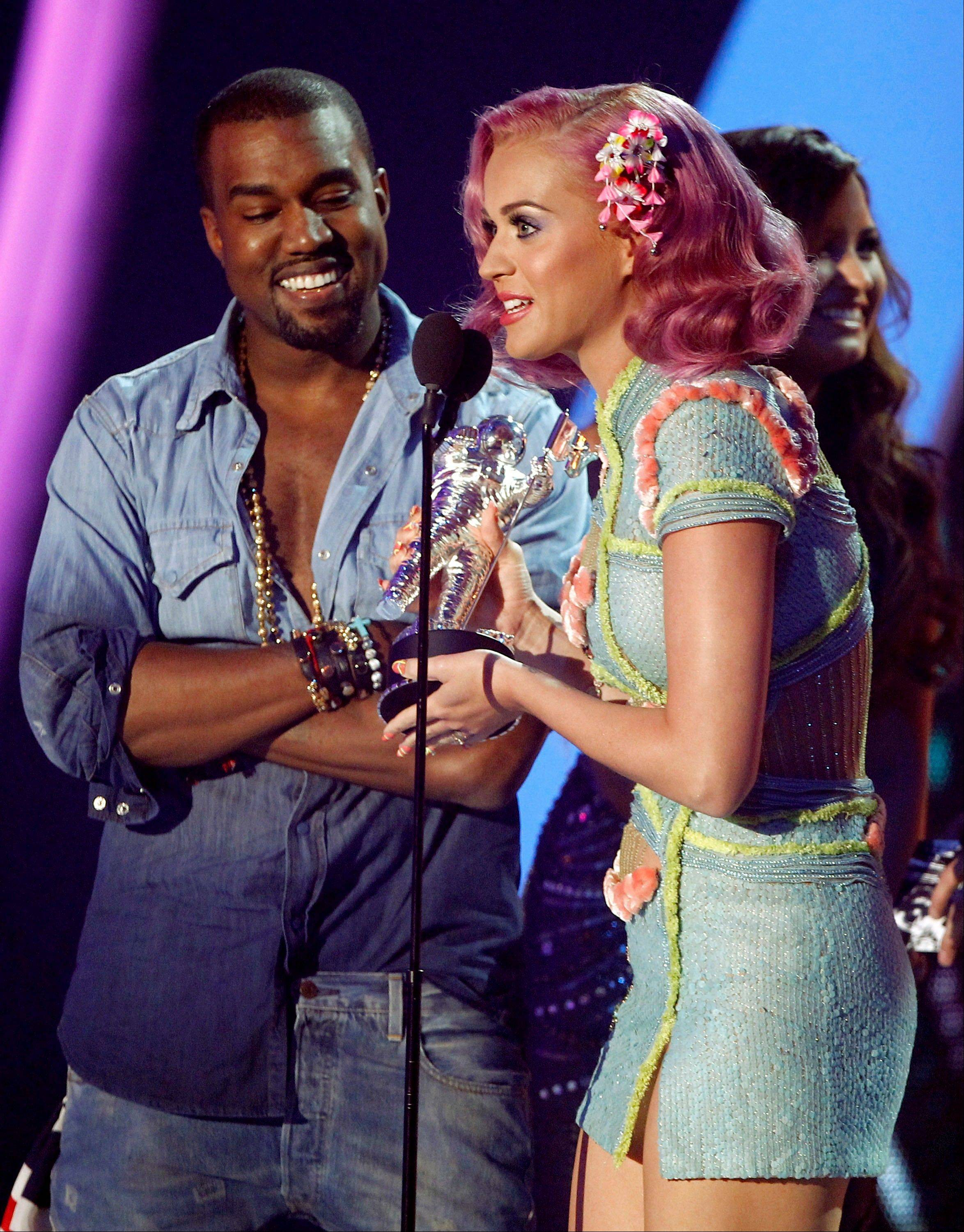 "Katy Perry accepts the award for best collaboration with Kanye West for ""E.T."" at the MTV Video Music Awards on Sunday in Los Angeles."