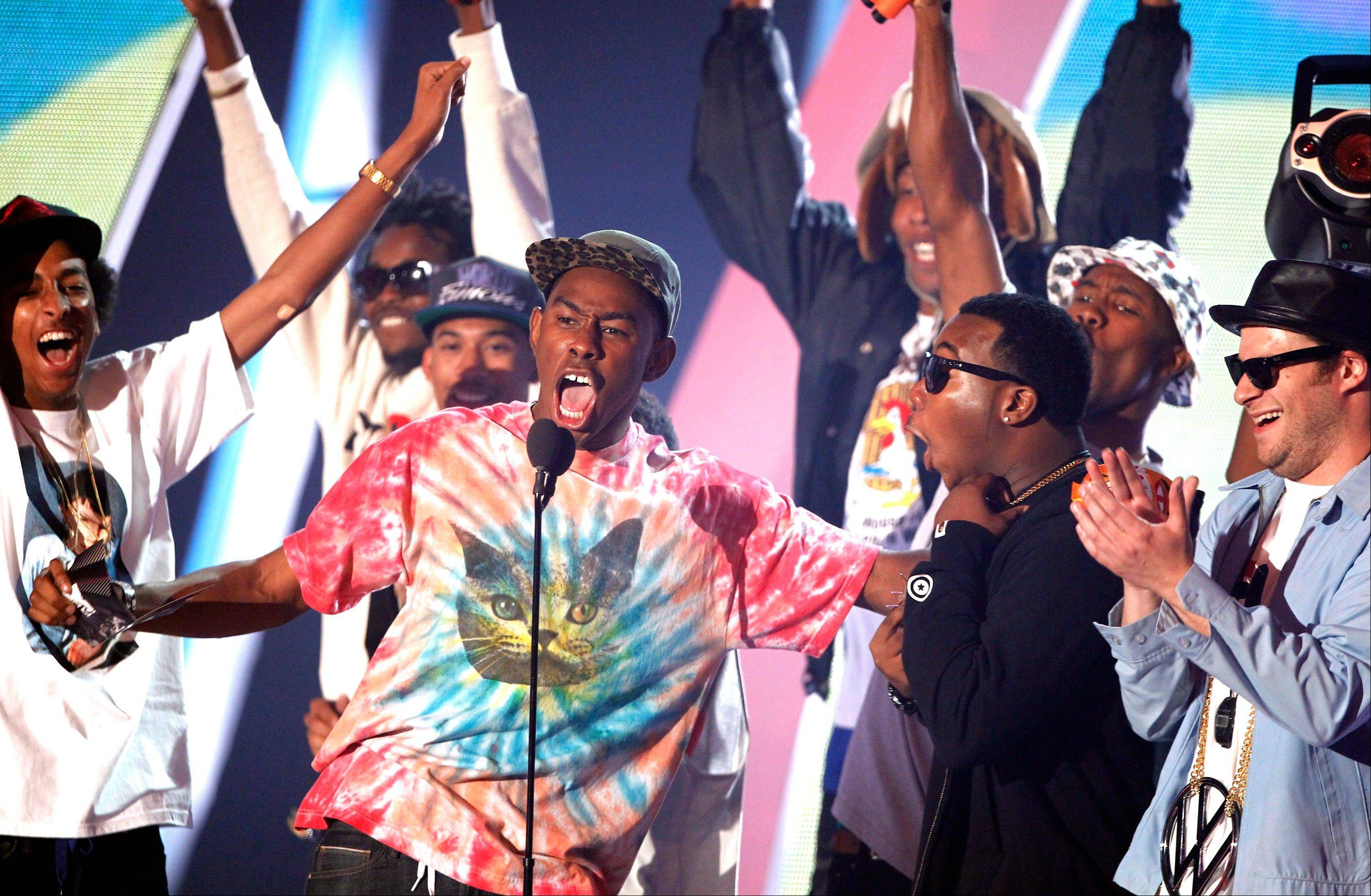 Tyler the Creator, center, presents the best hip hop video award at the MTV Video Music Awards on Sunday Aug. 28, 2011, in Los Angeles.