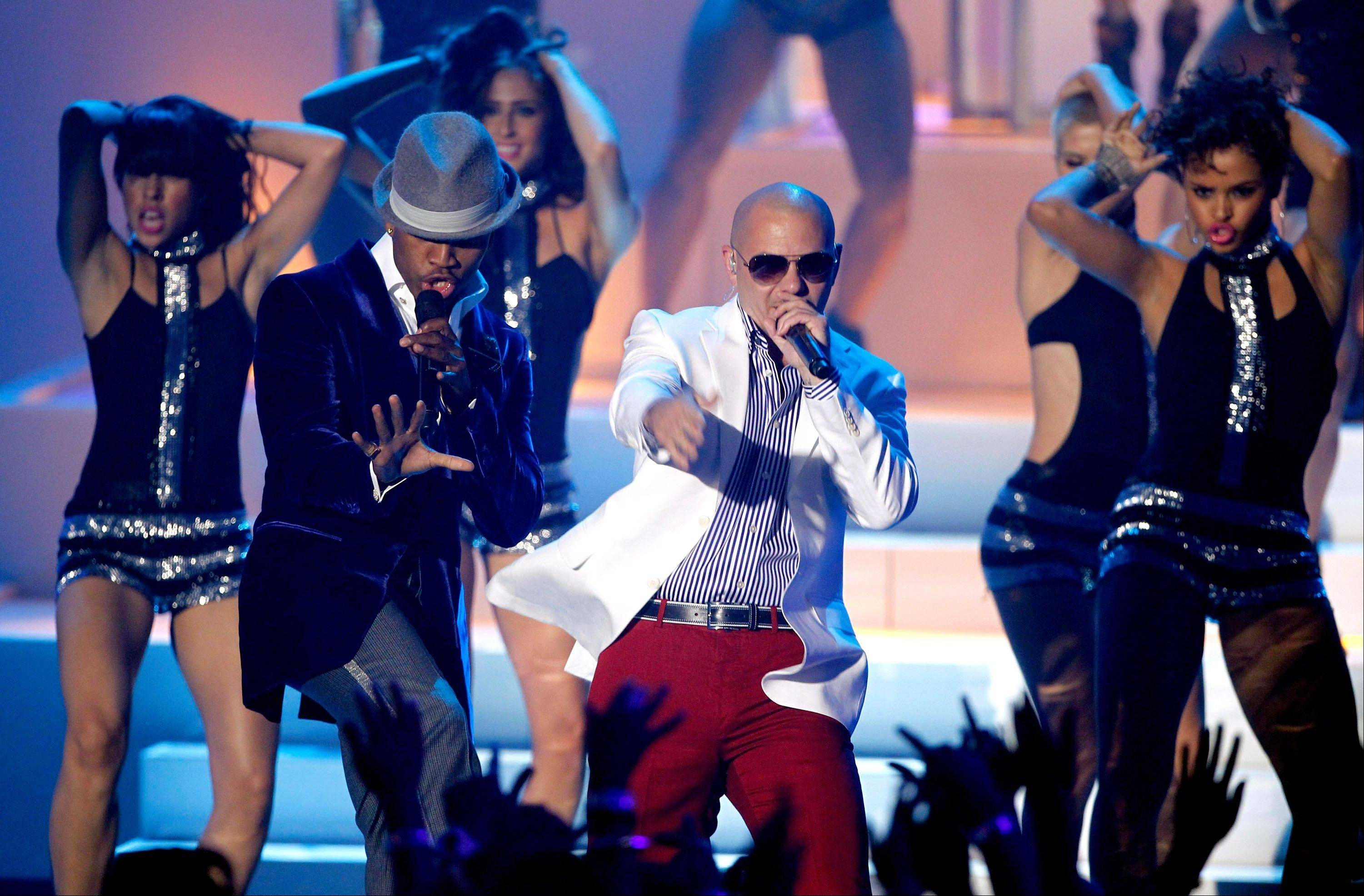 Ne-Yo, left, and Pitbull perform onstage at the MTV Video Music Awards on Sunday in Los Angeles.