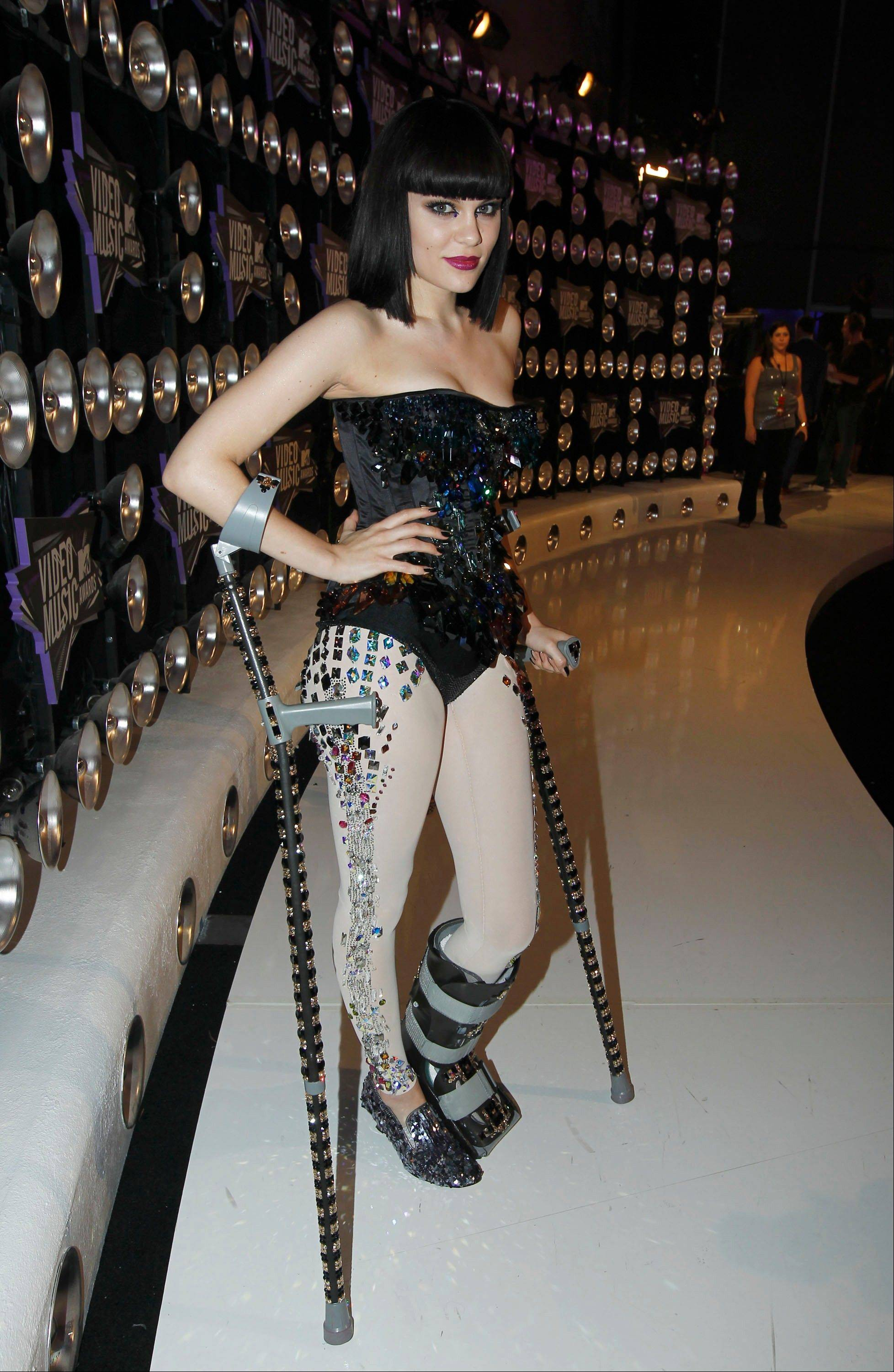 British singer Jessie J makes her way - crutches and all - into the VMAs Sunday in Los Angeles.