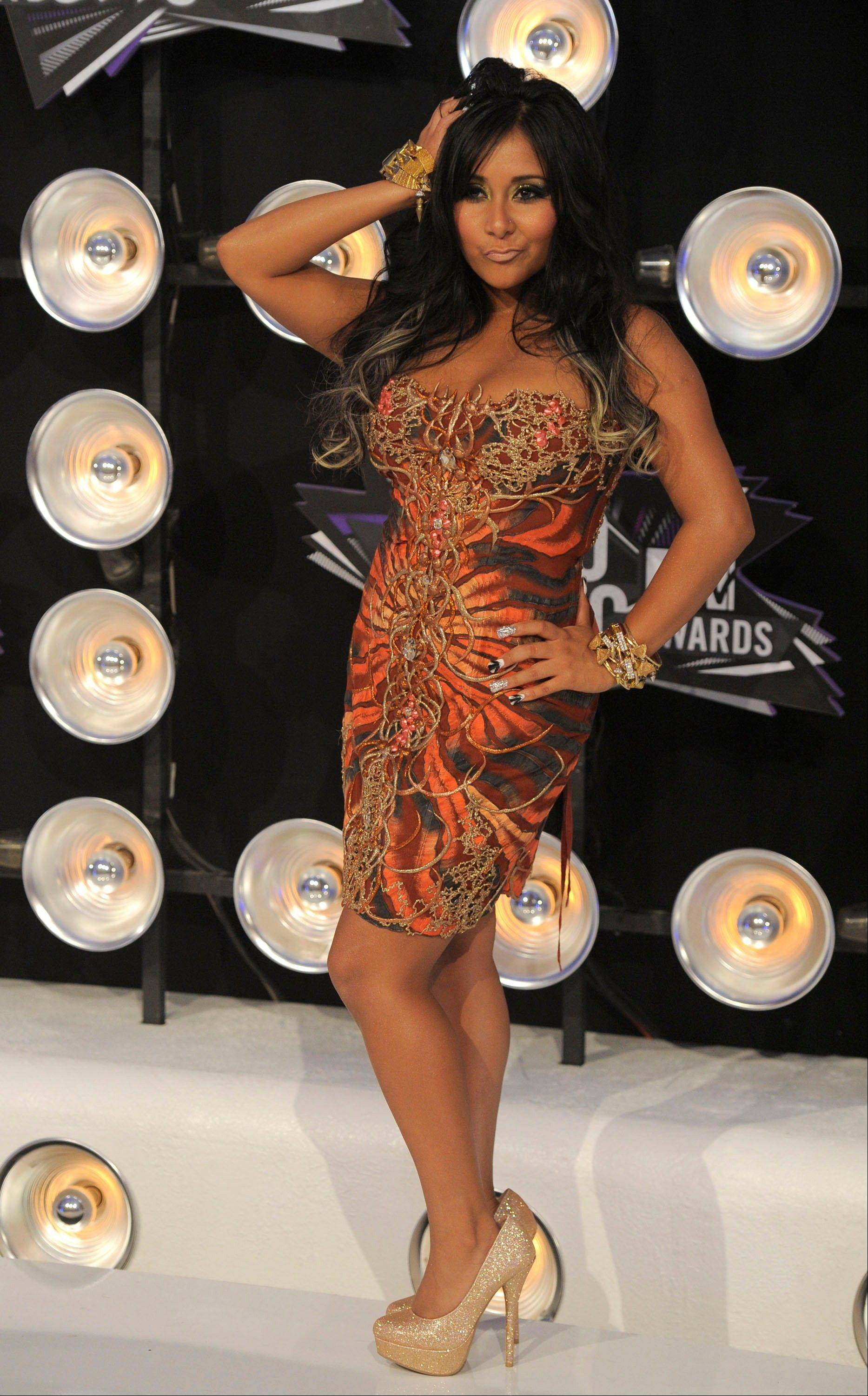 "Reality TV star Nicole ""Snooki"" Polizzi poses for the press at the MTV Video Music Awards on Sunday in Los Angeles."