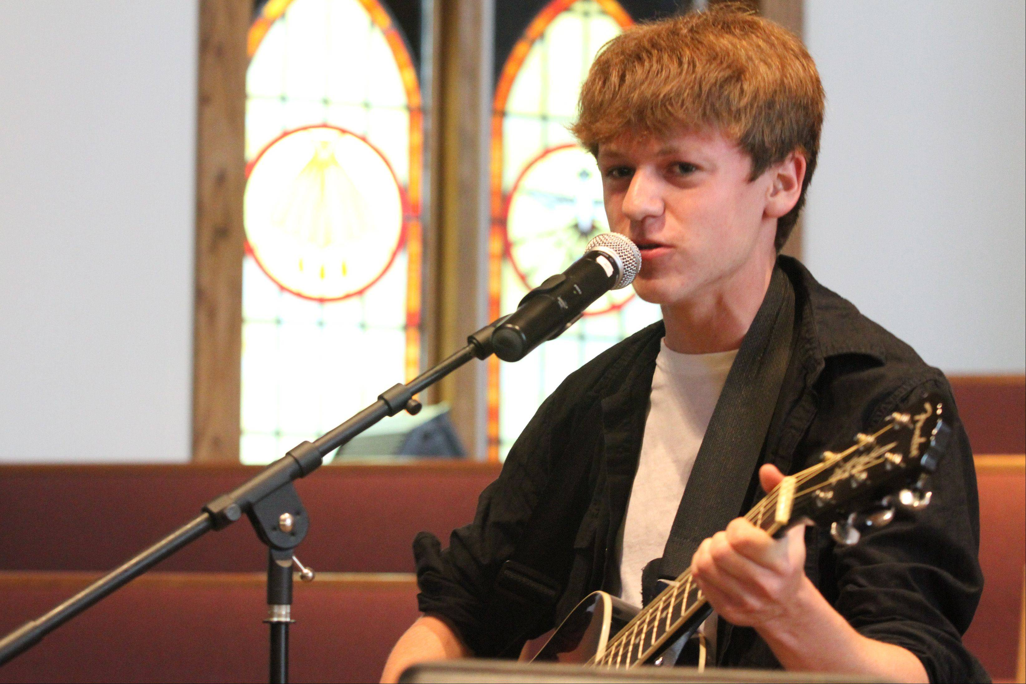 "Jeremy Benshish, 14, of South Elgin, sings ""Blue Suede Shoes"" during a benefit concert Sunday at Lutheran Church of the Master in Carol Stream. The event raised money for the family of Christian Moore, 5, of Glendale Heights, who has cerebral palsy."