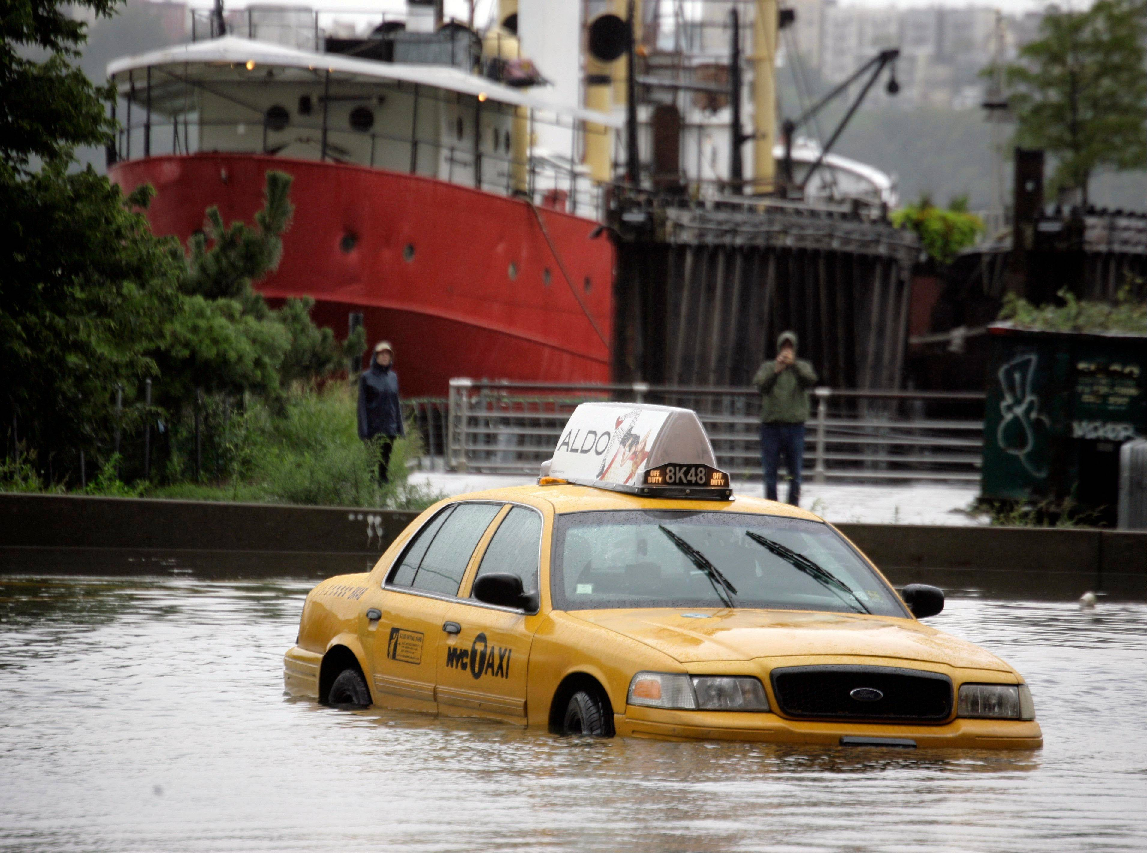 A New York City taxi is stranded in deep water on Manhattan�s West Side as Tropical Storm Irene passes through the city, Sunday, Aug. 28, 2011 in New York. Although downgraded from a hurricane to a tropical storm, Irene�s torrential rain couple with high winds and tides worked in concert to flood parts of the city.