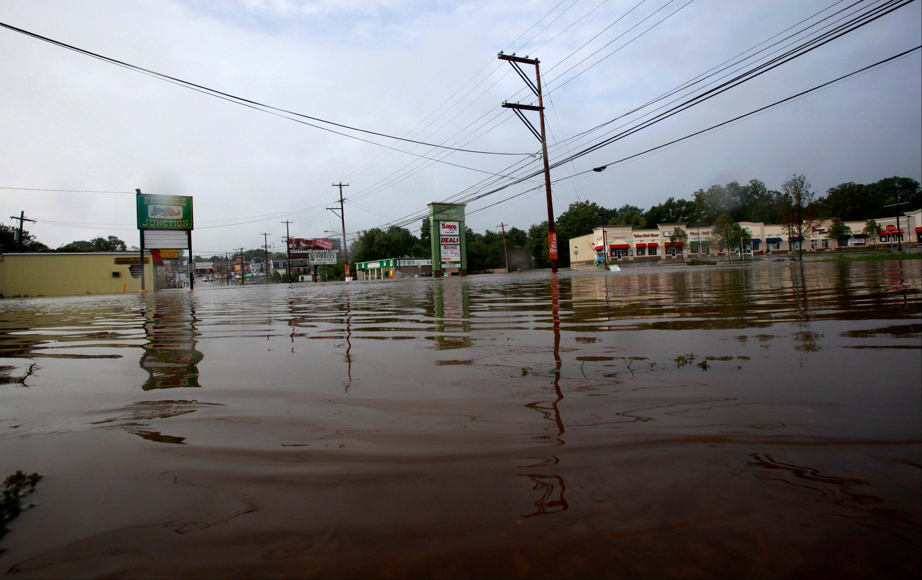 Business are flooded along on McDade Blvd. in Darby, Pa near Philadelphia Sunday Aug. 28, 2011. Irene slammed into Pennsylvania overnight, bringing rain and gusty winds that generated widespread flooding, toppled trees, and power outages.
