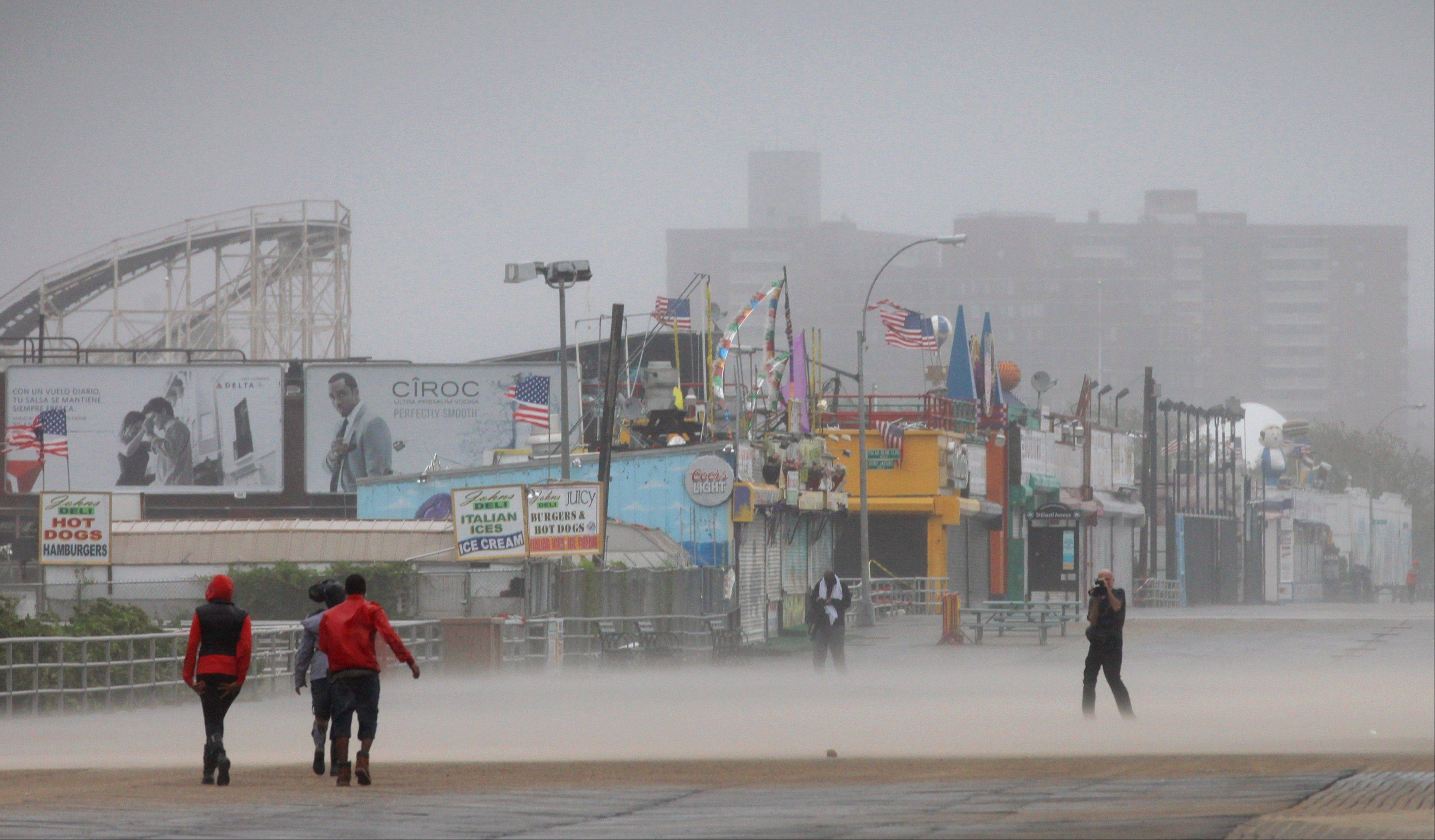 Driving wind and rain lash the Coney Island boardwalk in New York as Irene came closer to the area Sunday, Aug. 28 2011. Irene hit Coney Island with 65-mph winds, making it now a tropical storm.