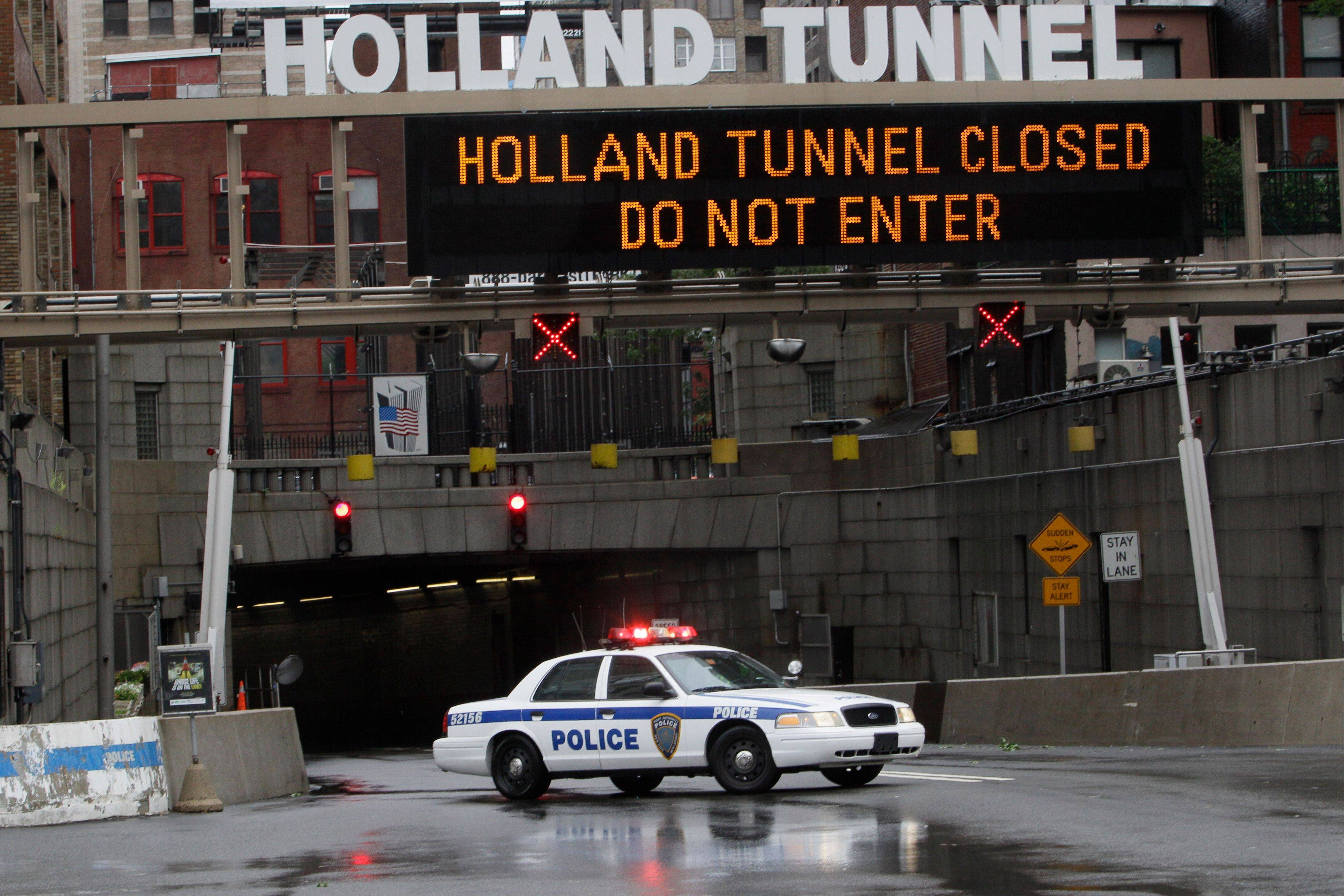 A Port Authority police vehicle blocks traffic from entering the Holland Tunnel Sunday, Aug. 28, 2011 in New York. The north, or New Jersey-bound side of the Holland Tunnel was closed Sunday morning because of flooding from Tropical Storm Irene's rains.