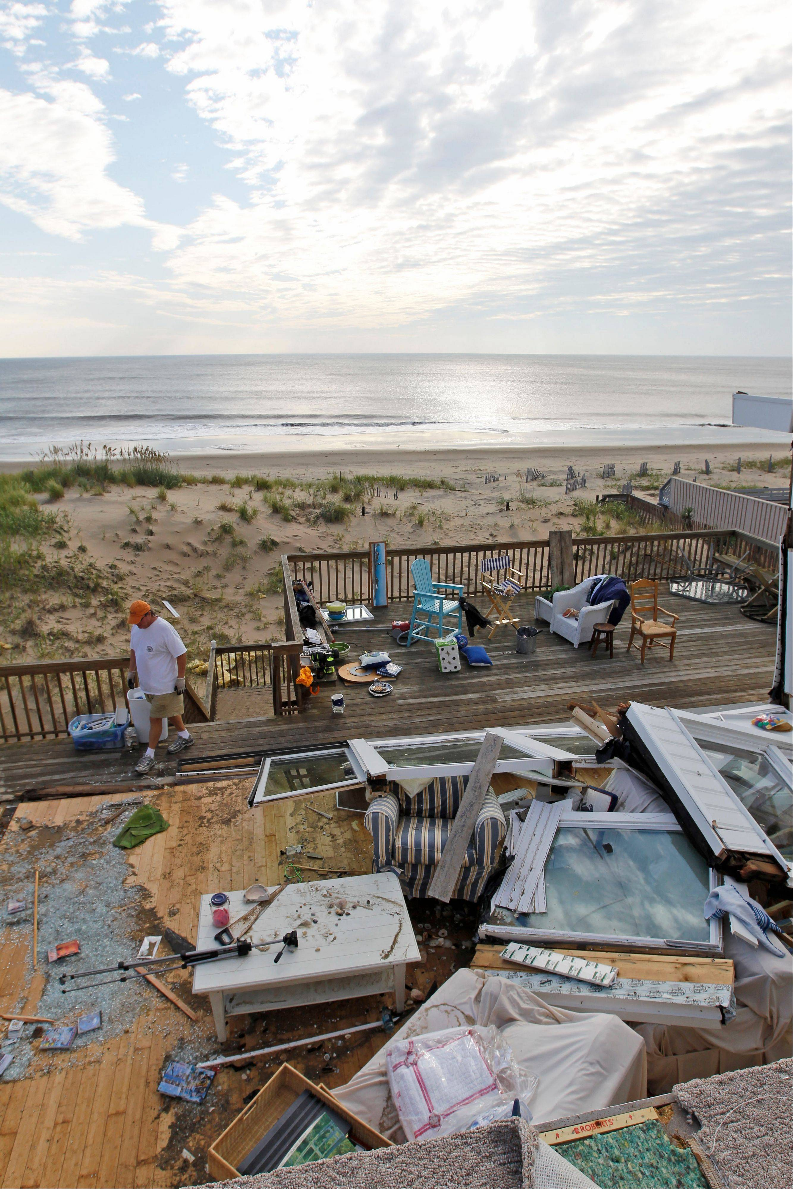Casey and Denise Robinson clear out their destroyed beach home in the Sandbridge area of Virginia Beach, Va., Sunday, Aug. 28, 2011, the day after Hurricane Irene moved through. Officials speculate that a tornado swept through the area.