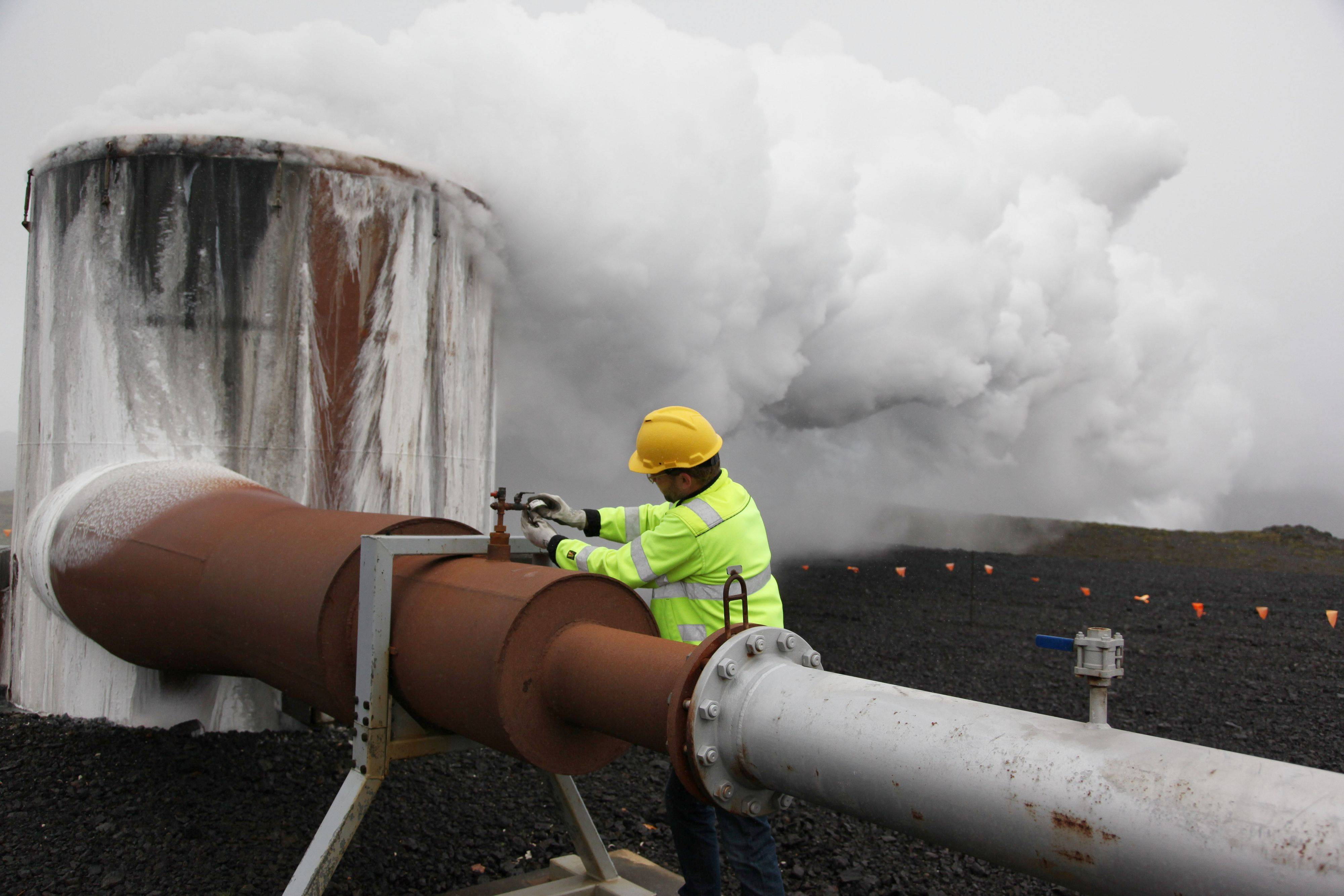 Bergur Sigfusson, the CarbFix experiment's technical manager, checks a valve at a test well at Reykjavik Energy's Hellisheidi geothermal power plant in Iceland. CarbFix's scientists will separate carbon dioxide from the volcanic field's steam and pump it underground to react with porous basalt rock, forming limestone, to see how well the gas most responsible for global warming can be locked away in harmless form.