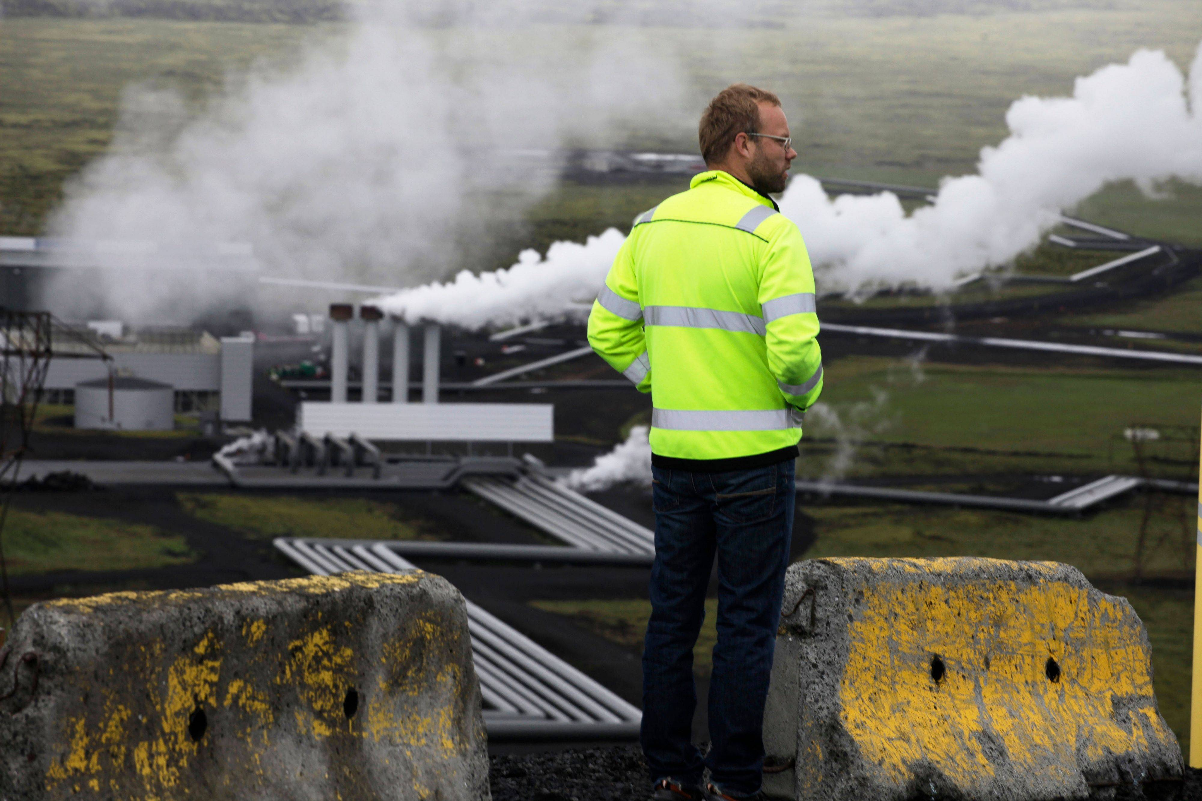 Bergur Sigfusson, the CarbFix experiment's technical manager, surveys Reykjavik Energy's Hellisheidi geothermal power plant in Iceland. CarbFix's scientists will separate carbon dioxide from the volcanic field's steam and pump it underground to react with porous basalt rock, forming limestone, to see how well the gas most responsible for global warming can be locked away in harmless form.