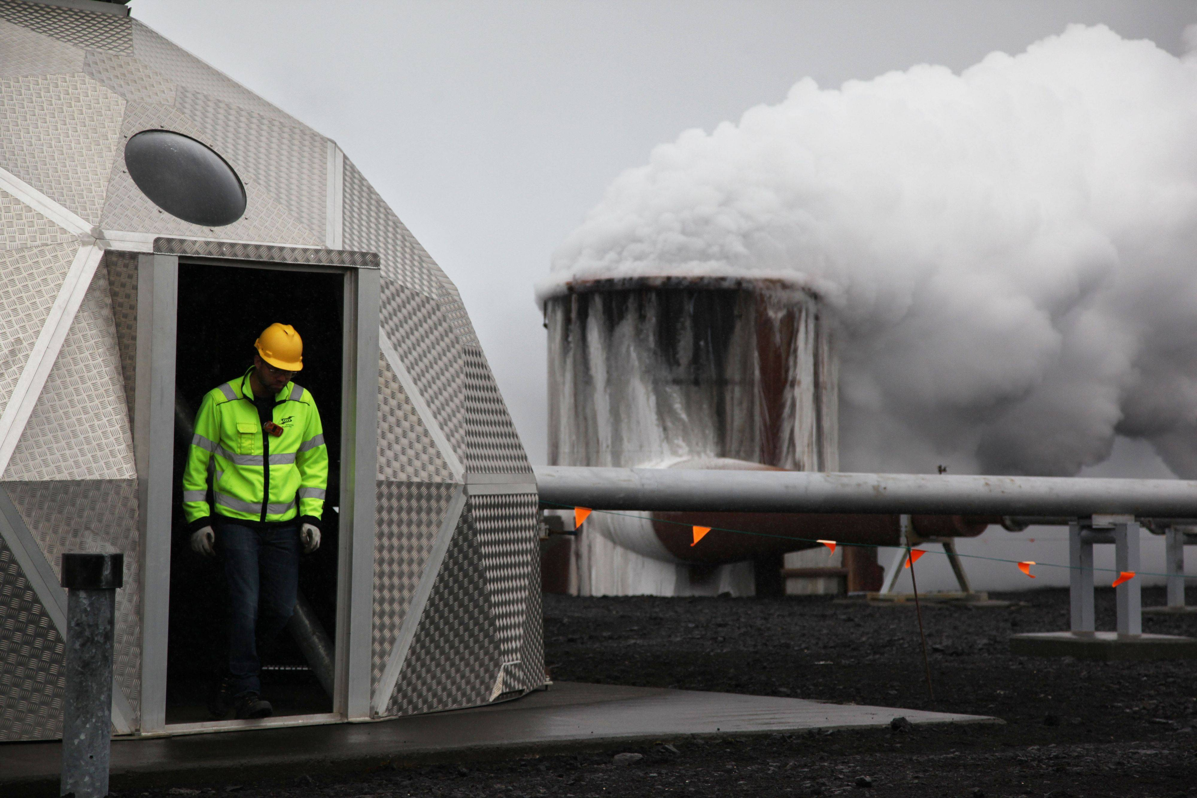 Bergur Sigfusson, the CarbFix experiment's technical manager, inspects a test well at Reykjavik Energy's Hellisheidi geothermal power plant in Iceland. CarbFix's scientists will separate carbon dioxide from the volcanic field's steam and pump it underground to react with porous basalt rock, forming limestone, to see how well the gas most responsible for global warming can be locked away in harmless form.