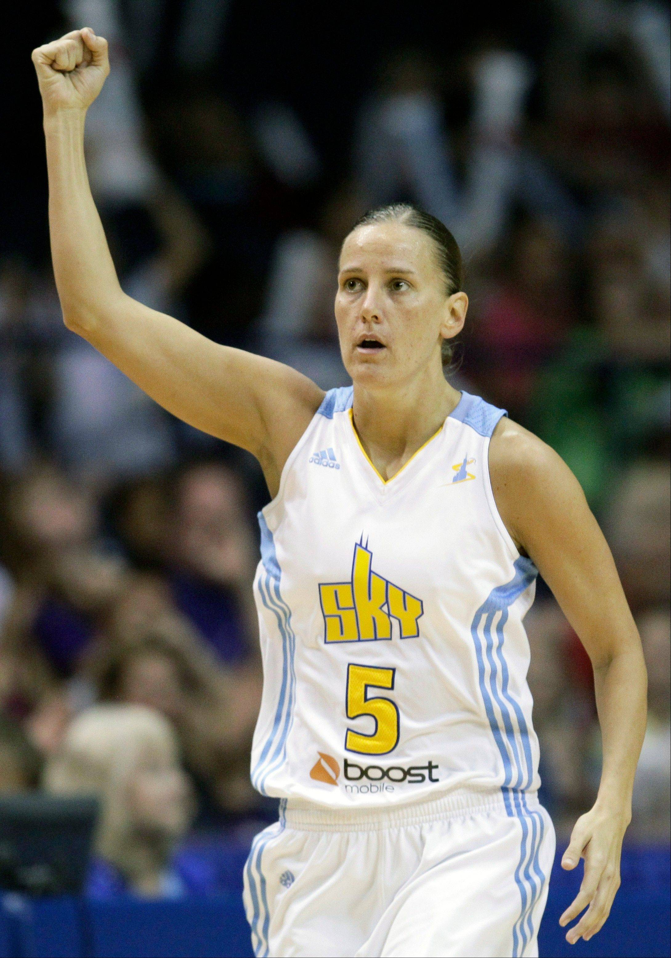 Chicago Sky's Erin Thorn celebrates after scoring a three- points shot during the fourth quarter of an WNBA basketball game against the New York Liberty on Sunday, Aug. 28, 2011, in Rosemont, Ill. The Sky won 74-73.