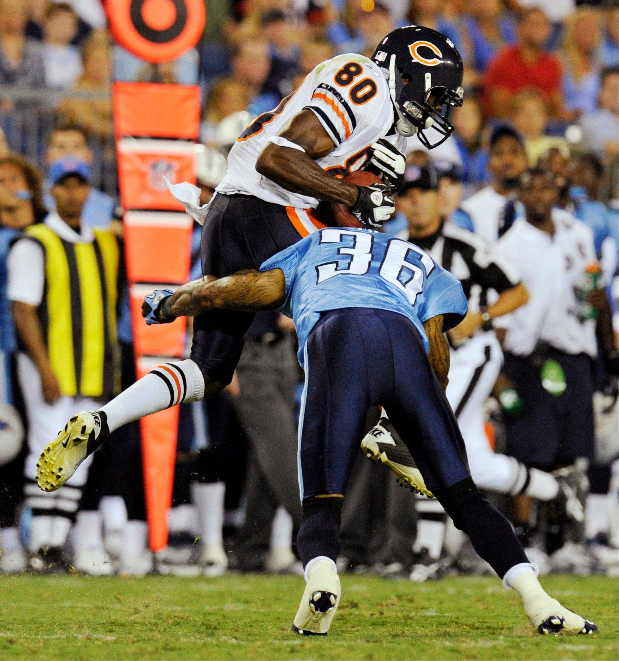 Bears wide receiver Earl Bennett makes a catch as he is hit by Tennessee Titans defensive back Anthony Smith in the third quarter Saturday.