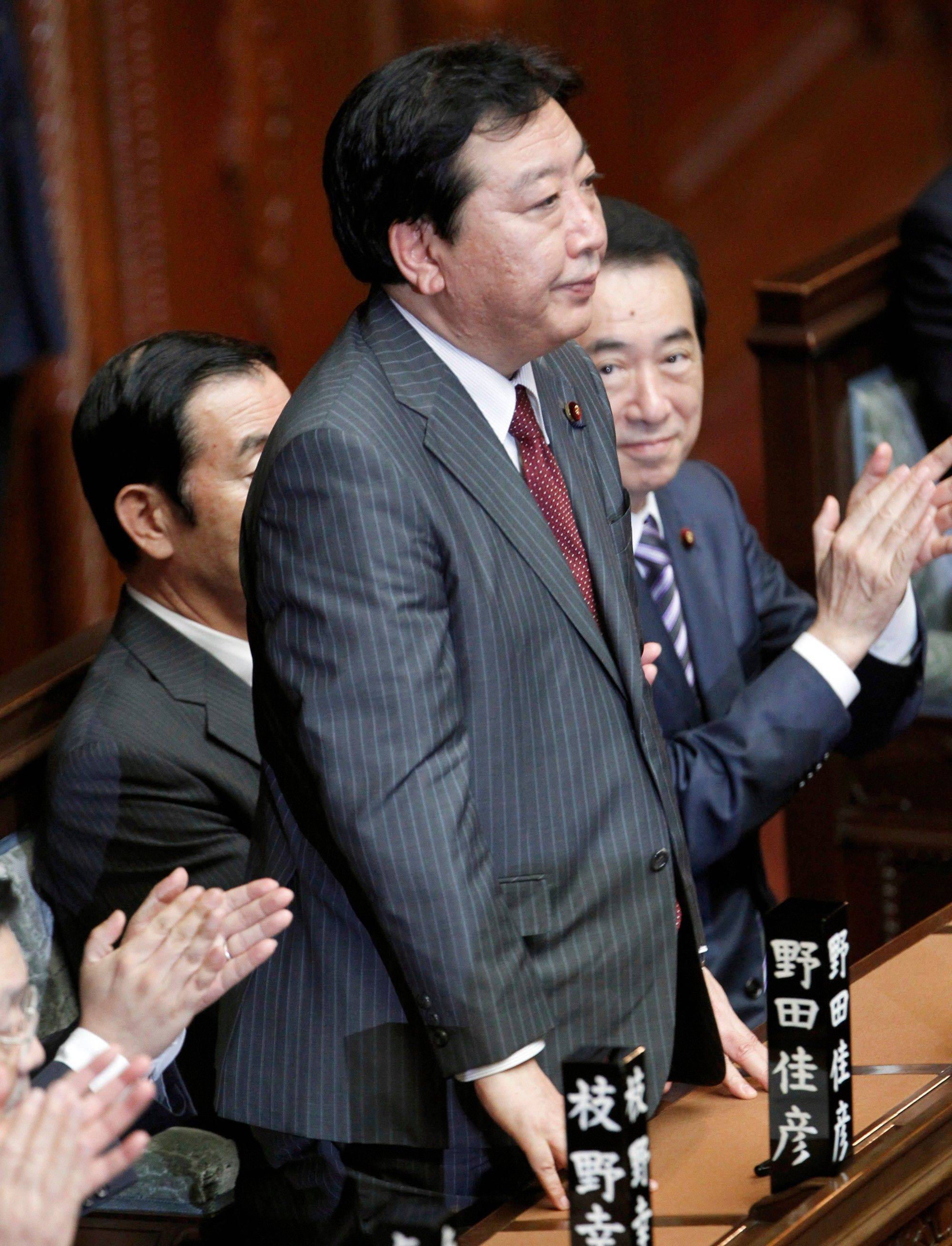 Yoshihiko Noda, new leader of the ruling Democratic Party of Japan, stands after Japan�s lower house elected him the country�s new prime minister at the parliament in Tokyo Tuesday.