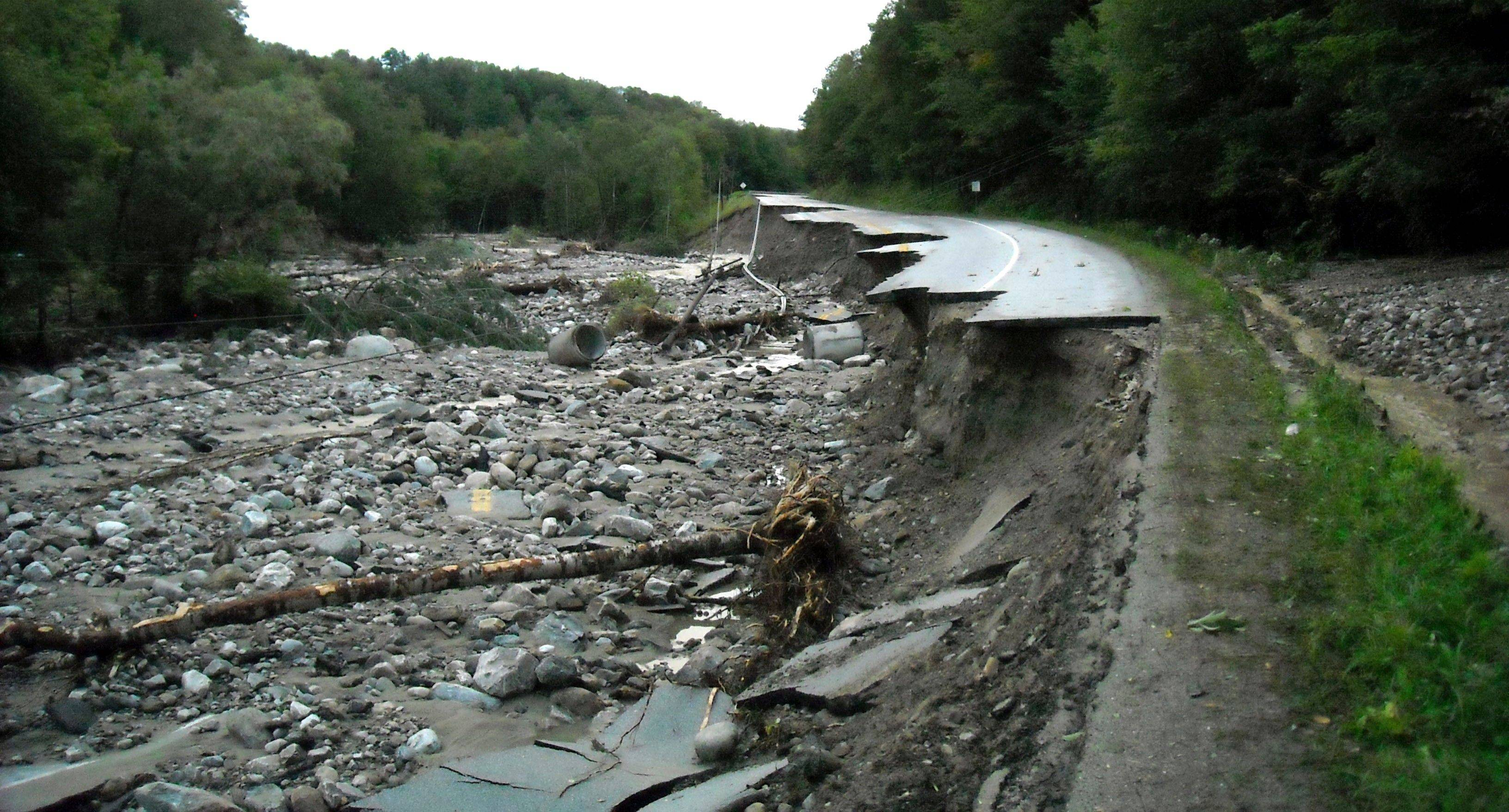 A washed-out road in Mendon, Vt., is seen Monday, after the adjacent Mendon Brook overflowed from floodwaters relating to Tropical Storm Irene.