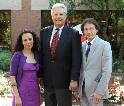Camille Harrison, left, and Larry Cohen, right, celebrate their teaching awards with Tom Tippett, grants committee chairman for the Oakton Educational Foundation board of directors.