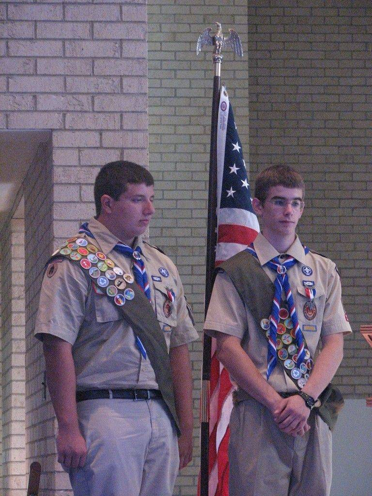 Kevin DeLozier, left, and Brandon Schott await their ceremonial award from the Marine Corps in honor of acquiring the rank of Eagle Scout.