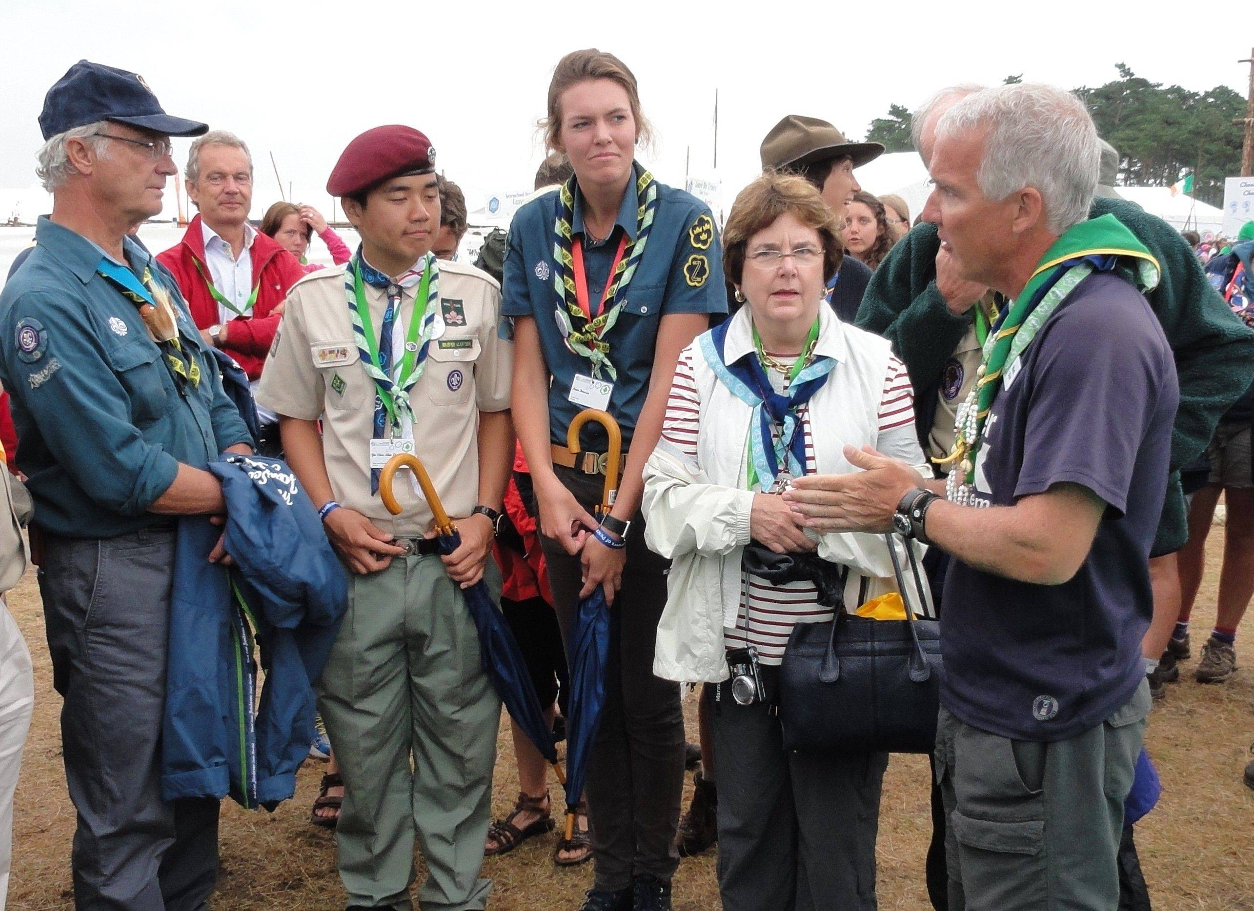 ShelterBox Response Team member Mark Dyer, right, explains the ShelterBox international disaster relief mission to Swedish King Carl XVI Gustaf, left. Dyer, who also serves as the ShelterBox Scout coordinator, welcomed the king to the ShelterBox display and adventure course at the 2011 World Scout Jamboree in Sweden.
