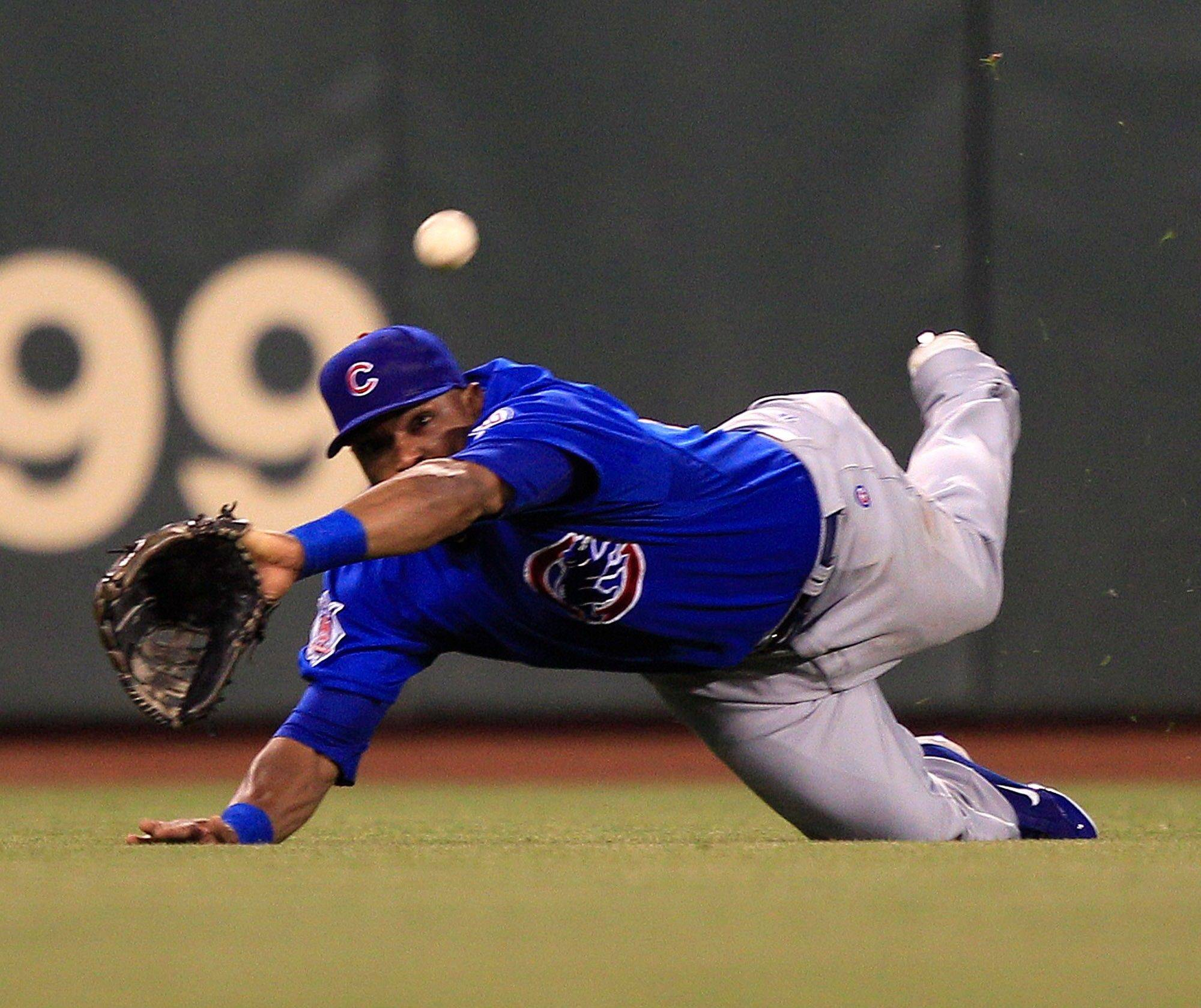 Cubs center fielder Marlon Byrd makes a diving attempt at a ball hit by the Giants� Andres Torres in the third inning Monday. Torres was safe with a double.