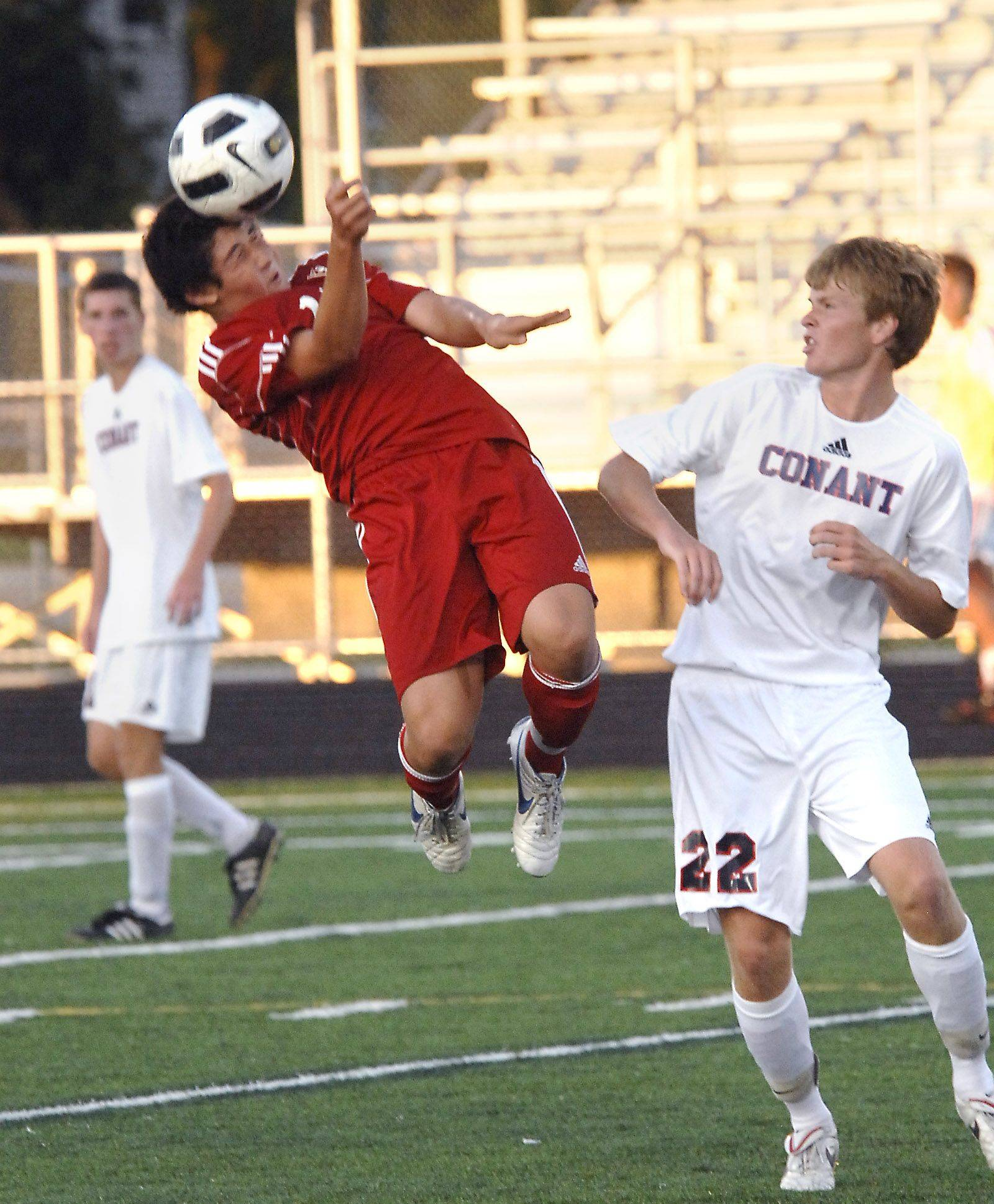 Palatine?s Tim Murphy (10) gets off a header against Conant?s Jamie Blonde on Monday at Conant.