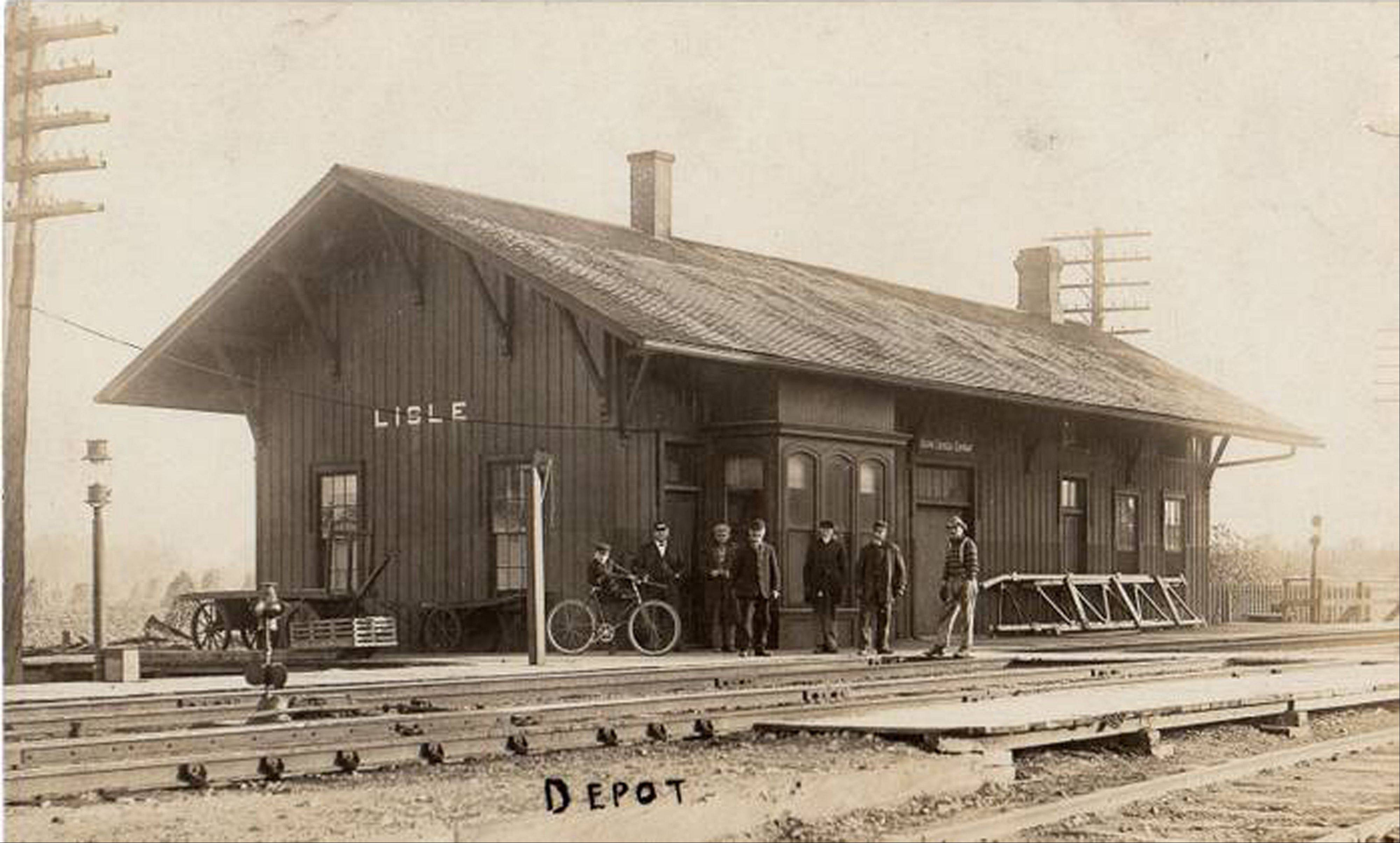 "This postcard, with a postmark from 1911, bears a message on the back reading, ""This is the depot in our famous city and is large enough for a town twice as large, so if you ever come to Lisle you will find the train service equal to that of Elmhurst."""