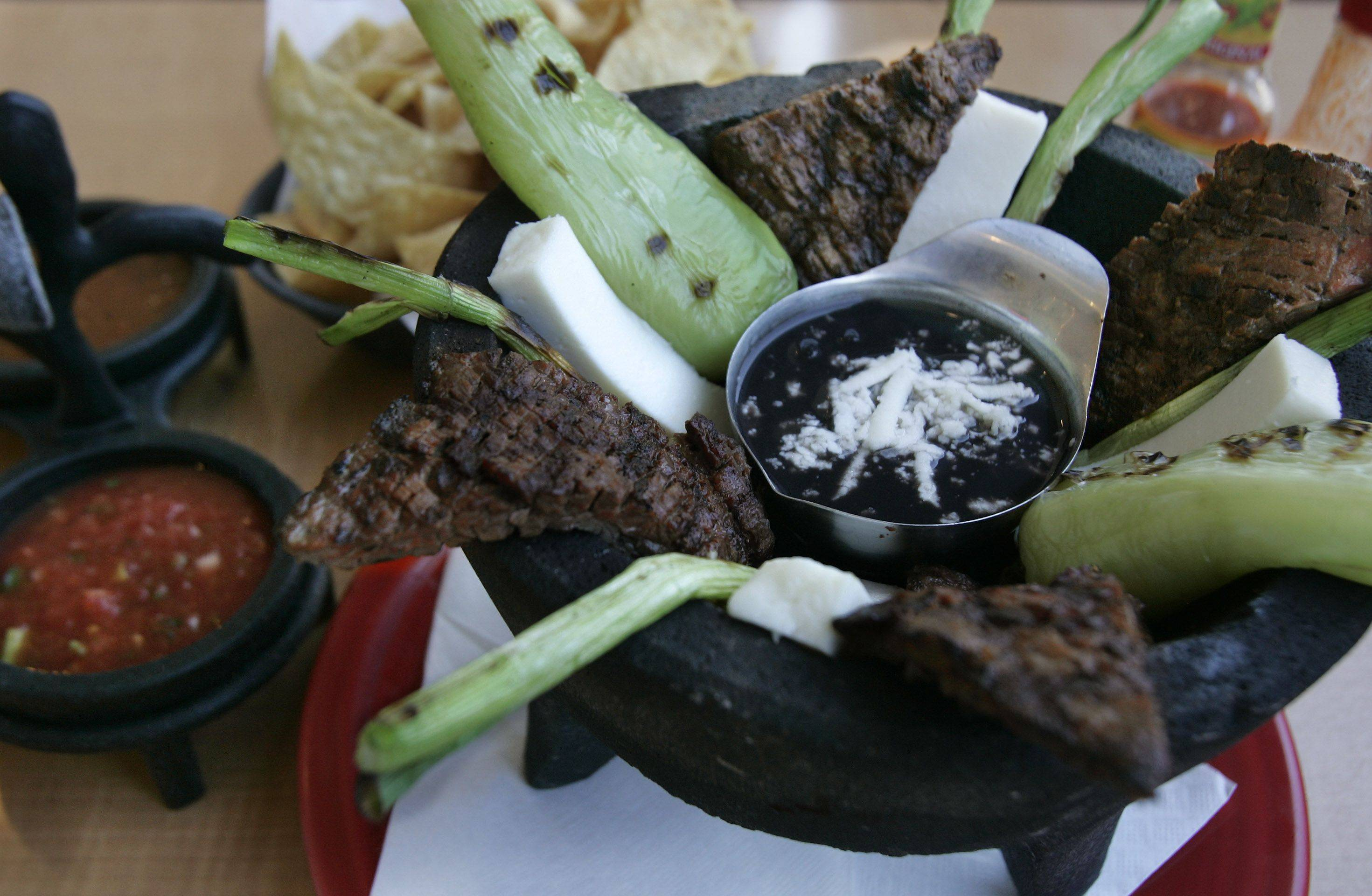 Molcajete — skirt steak with green onions, banana peppers, queso fresco and black beans — is one of the options at Casa Bonita in Libertyville.