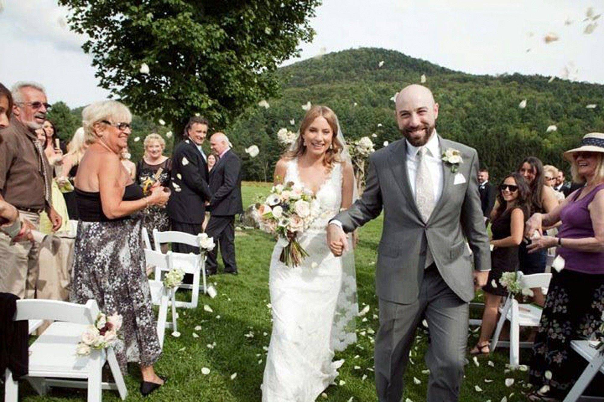 Marc and Janina Leibowitz were wed at Riverside Farm in Pittsfield, Vt., on Saturday. The couple remains stranded with 60 of their wedding guests in Pittsfield Tuesday, after Tropical Storm Irene washed away bridges and their main road out on Sunday.