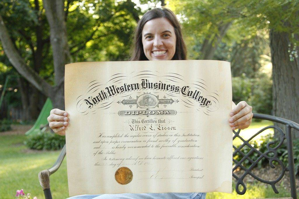 Carolyn Kuhn of Naperville holds the diploma of her great-grandfather Al Lisson Sr., who was part of the class of 1901 North Central College. The institution was called North Western College when Lisson attended.