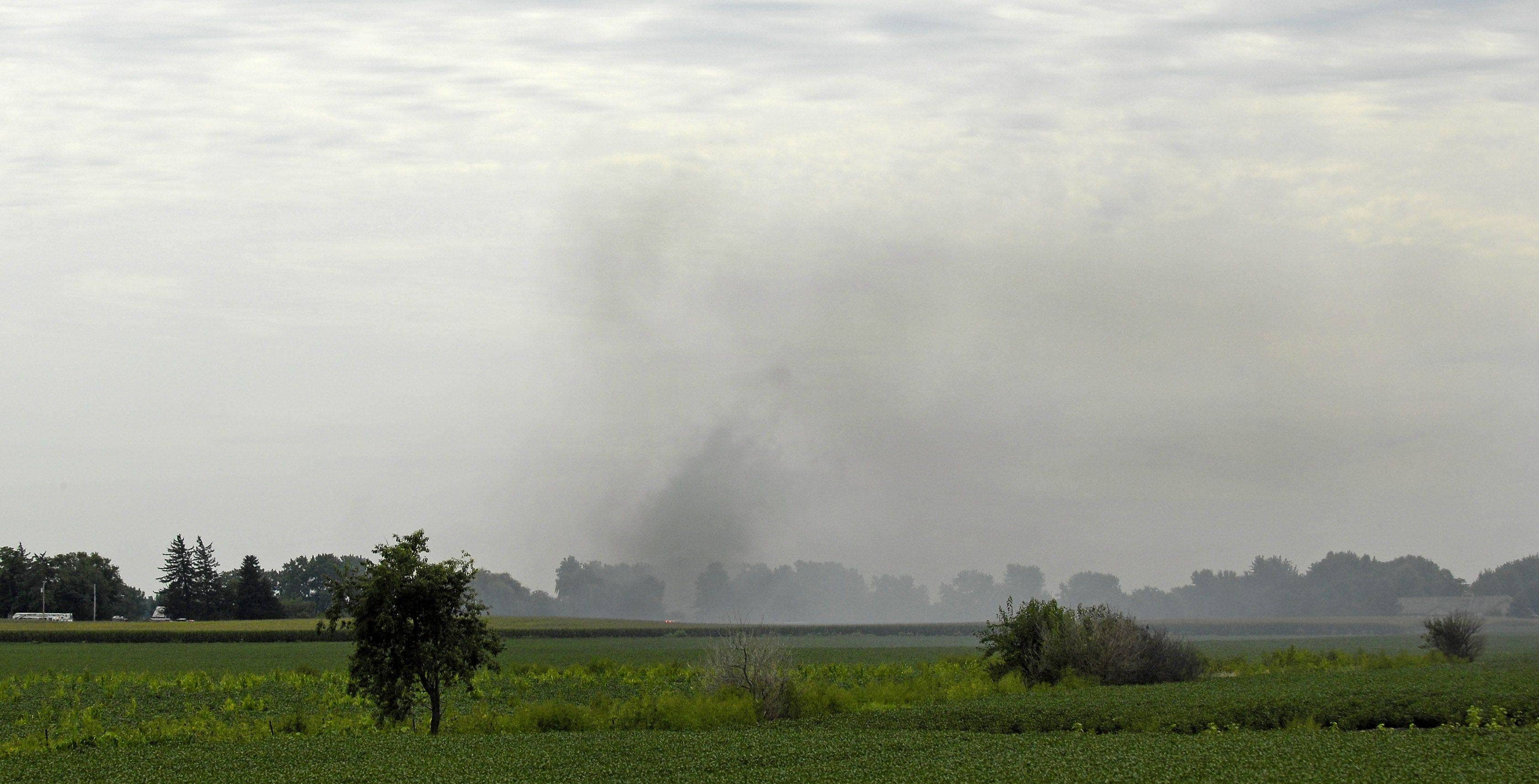 Smoke from a building fire on Thatcher Road fills the sky in Maple Park Tuesday afternoon.
