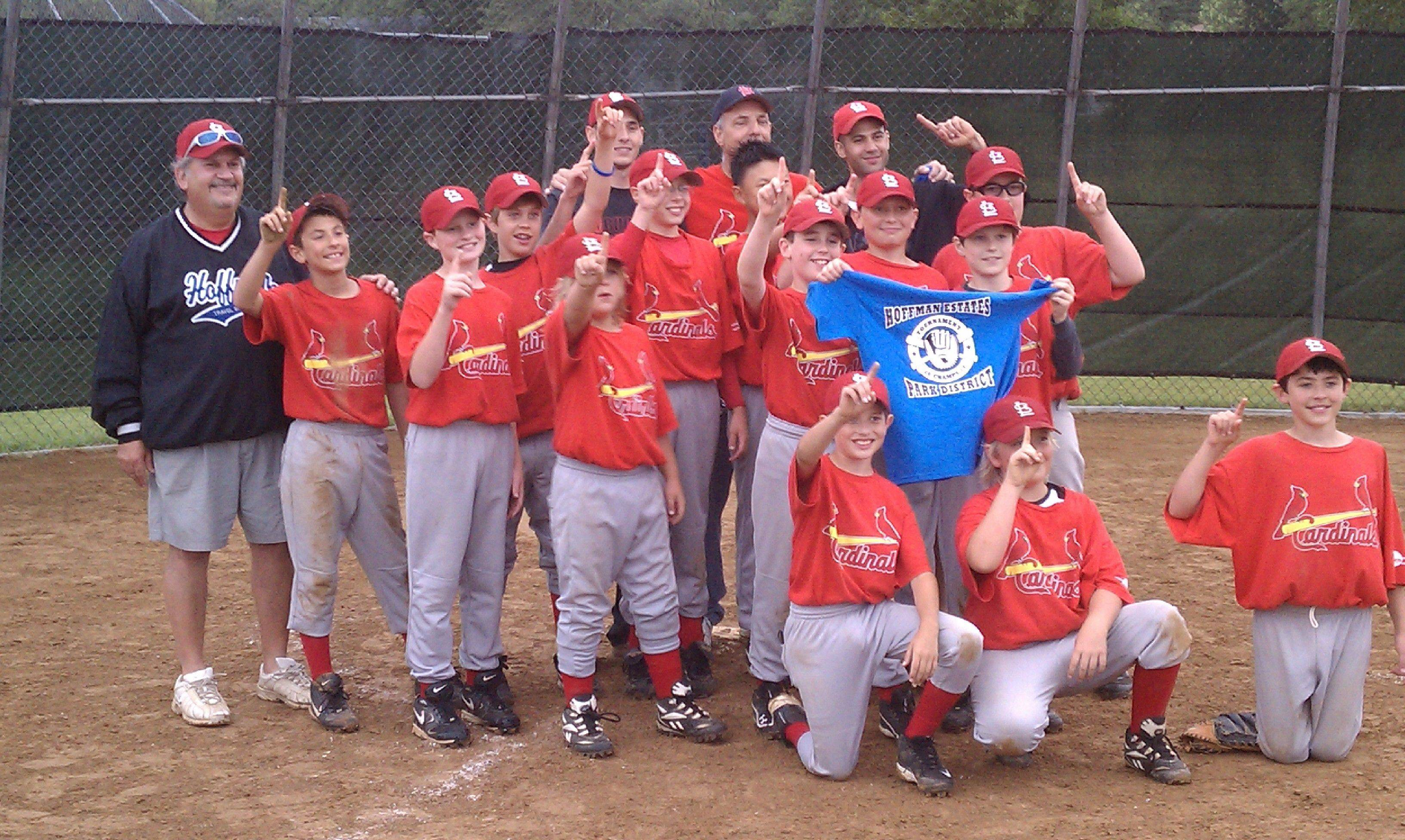 Marc Friedman, in blue, along with fellow coaches in the back row Kyle Sertich, David T. Sertich and David M. Sertich pose with their Bronco Cardinals baseball team after winning the park district league championship.