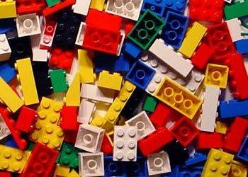 Danish toy maker Lego says its first-half profit rose 32 percent as the family-owned company continued to increase its market share.