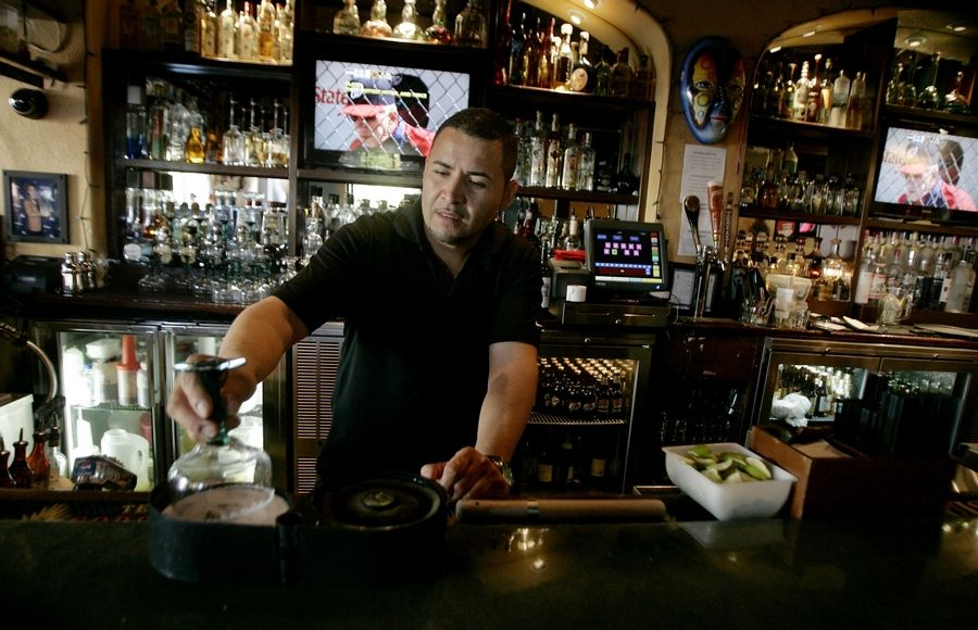 Bartender German Marquez offers up a selection of tequilas in the bar at Casa Bonita in Libertyville.