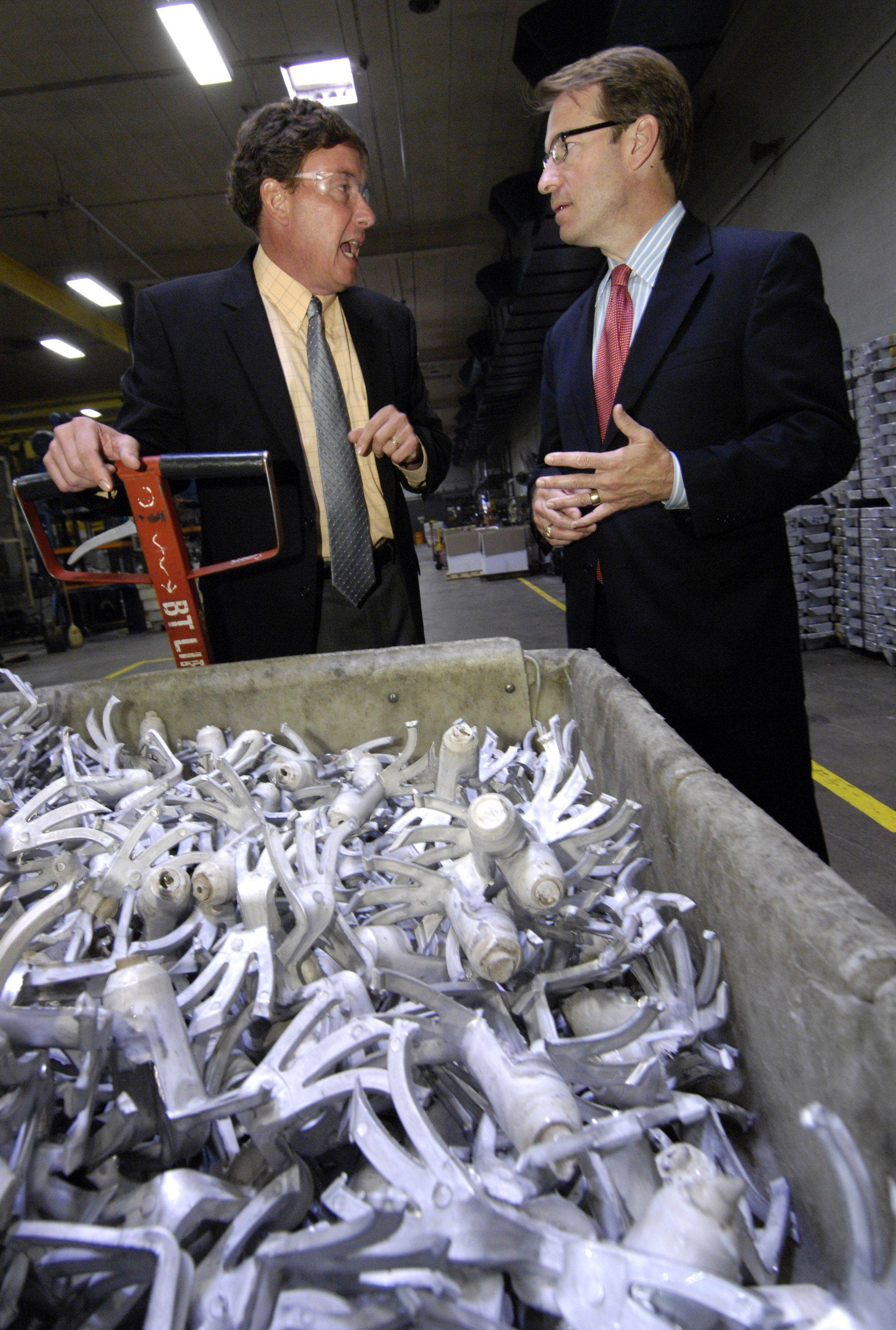 Chicago White Metal Casting President and CEO Eric Treiber gives Congressman Peter Roskam a tour of his Bensenville company on Tuesday.