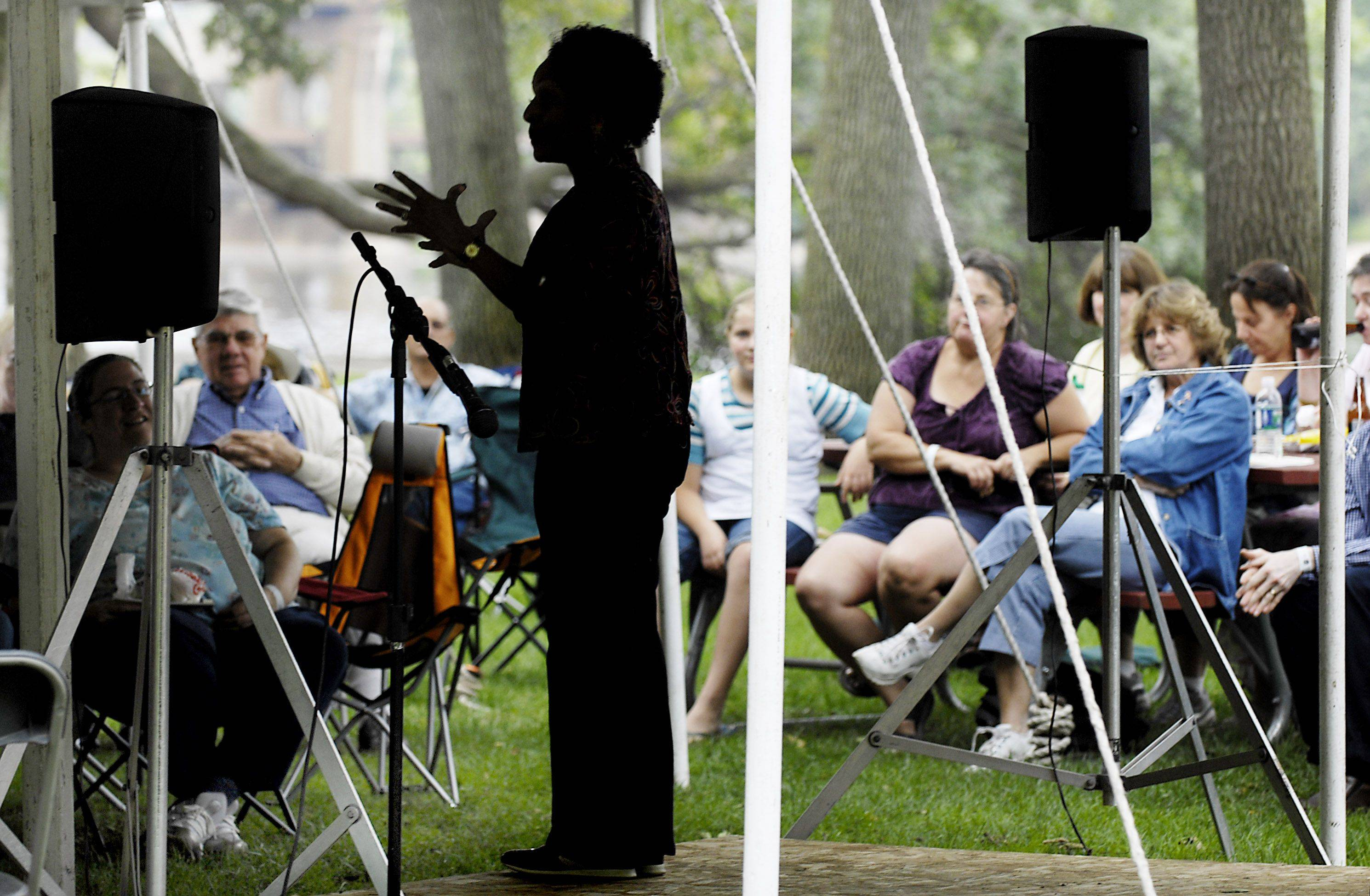 Storyteller Linda Gorham entertains a relaxed crowd at last year's Fox Valley Folk Music and Storytelling Festival in Island Park in Geneva.