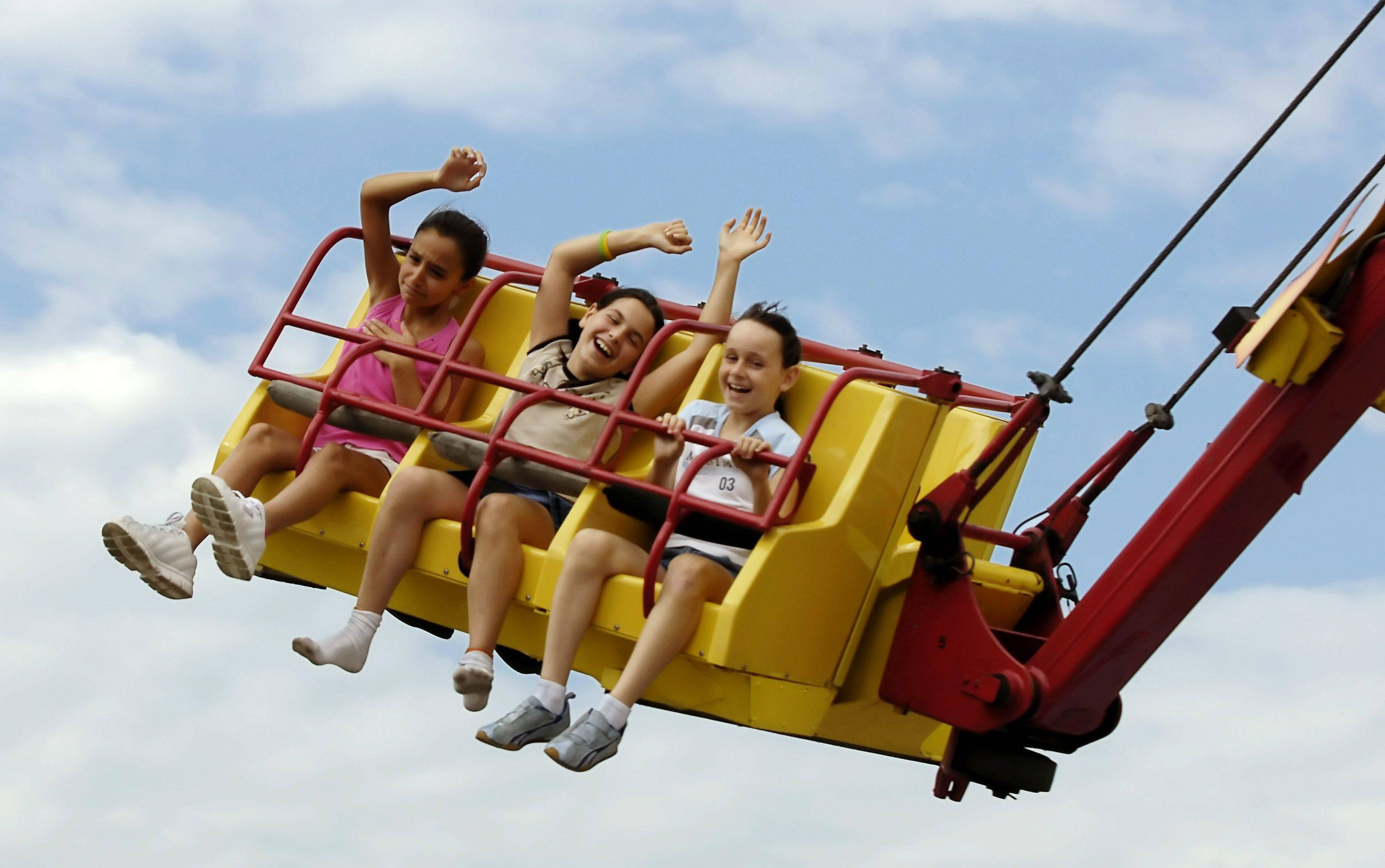 "Nine-year-olds from Elk Grove Village ride the ""Downdraft"" at the carnival at Septemberfest."