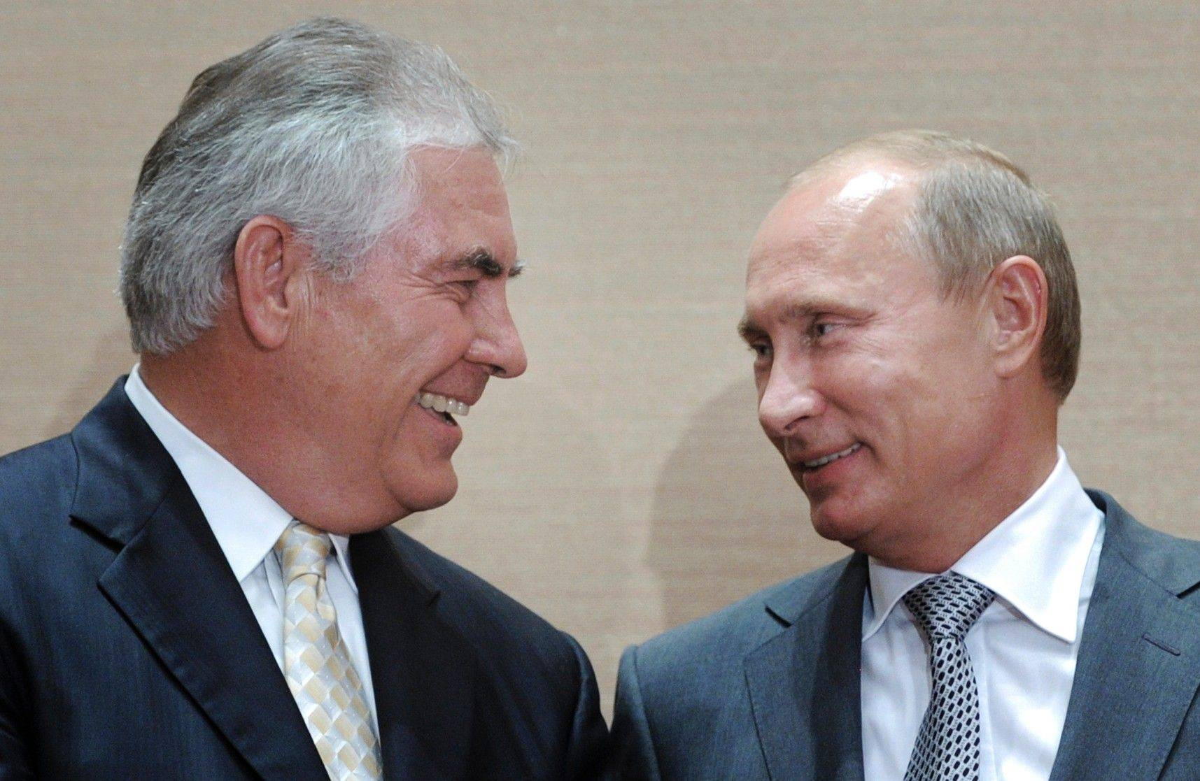 Russian Prime Minister Vladimir Putin, right, and Rex Tillerson, ExxonMobil's chief executive smile during a signing ceremony in the Black Sea resort of Sochi, Russia, Tuesday.