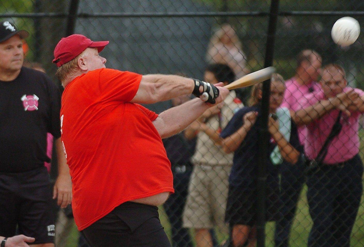Greg Hack takes a hack at a pitch during the 2010 charity softball game.