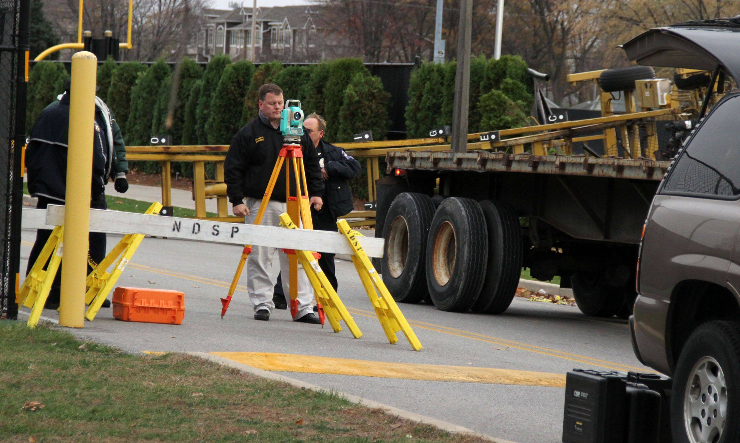 Investigators work next to the aerial lift that toppled over on Oct. 27, 2010, during a University of Notre Dame football practice, killing 20-year-old Declan Sullivan of Long Grove. Notre Dame, with help from Sullivan's family, has launched an aerial lift safety program.