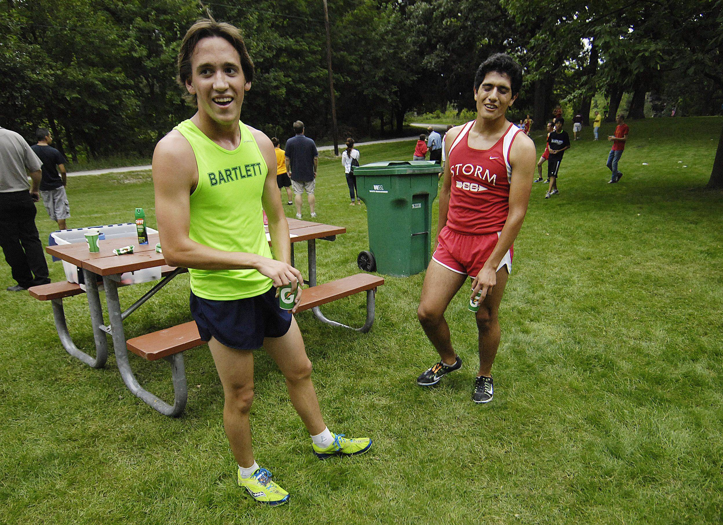 Second place finisher Joey Salatino of Bartlett and winner Francisco Garcia of South Elgin relax after finishing the Elgin cross country invitational Tuesday at Lords Park.